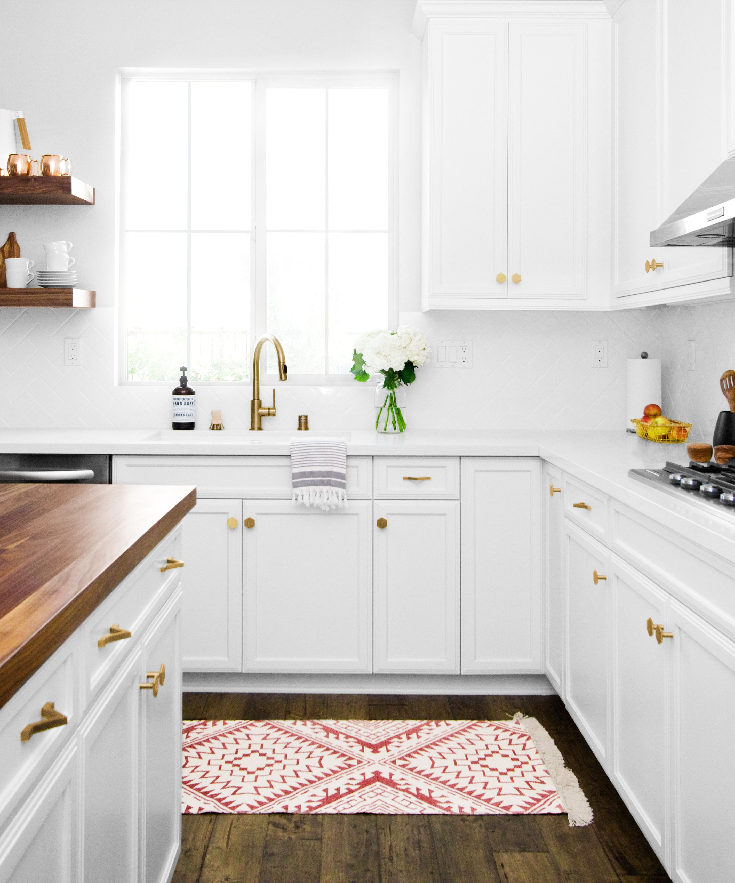 pugh project kitchen butcher block island floating shelves and gold accents