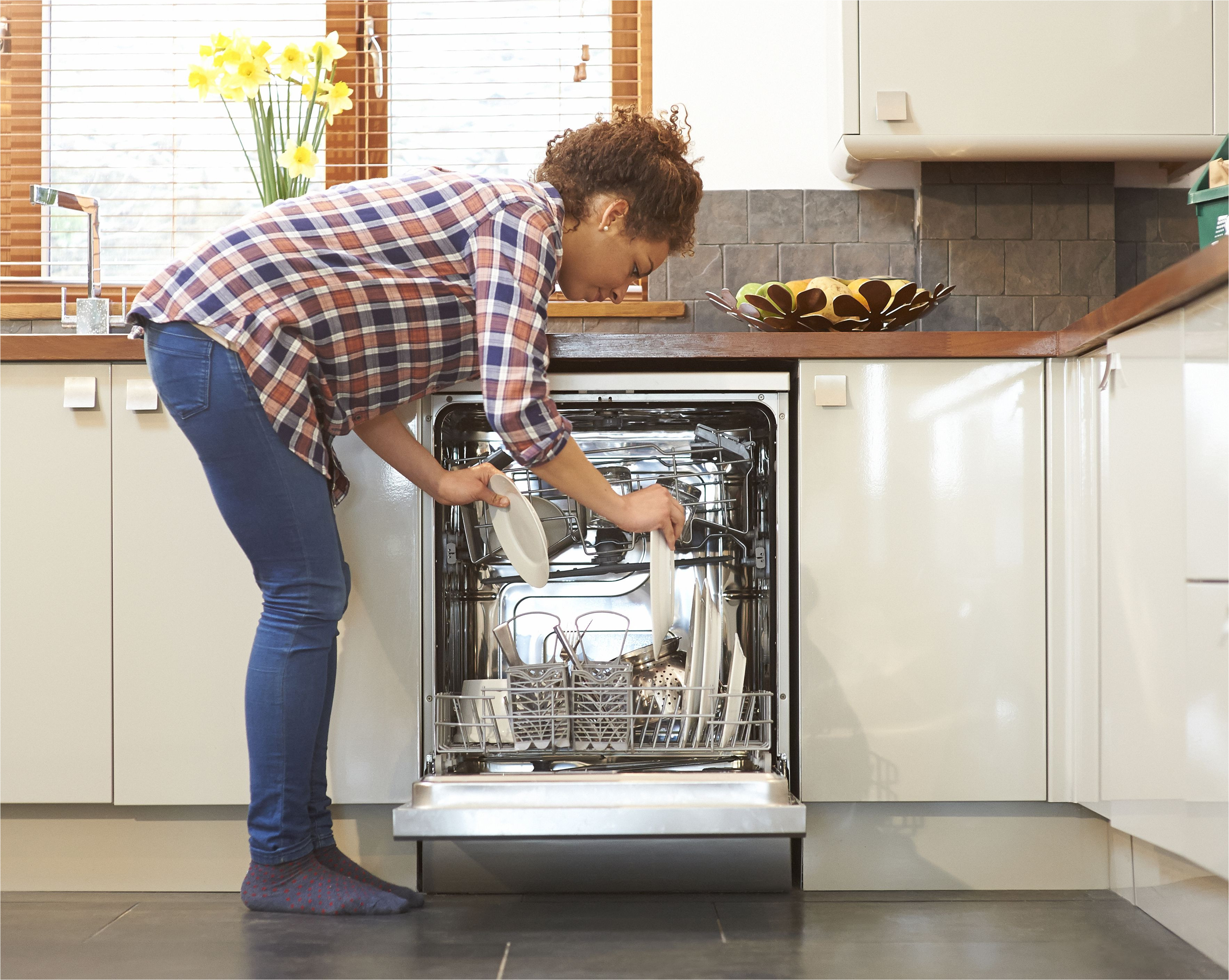 woman unloading dish washer in kitchen 483712233 57969bce3df78ceb8687e547 jpg