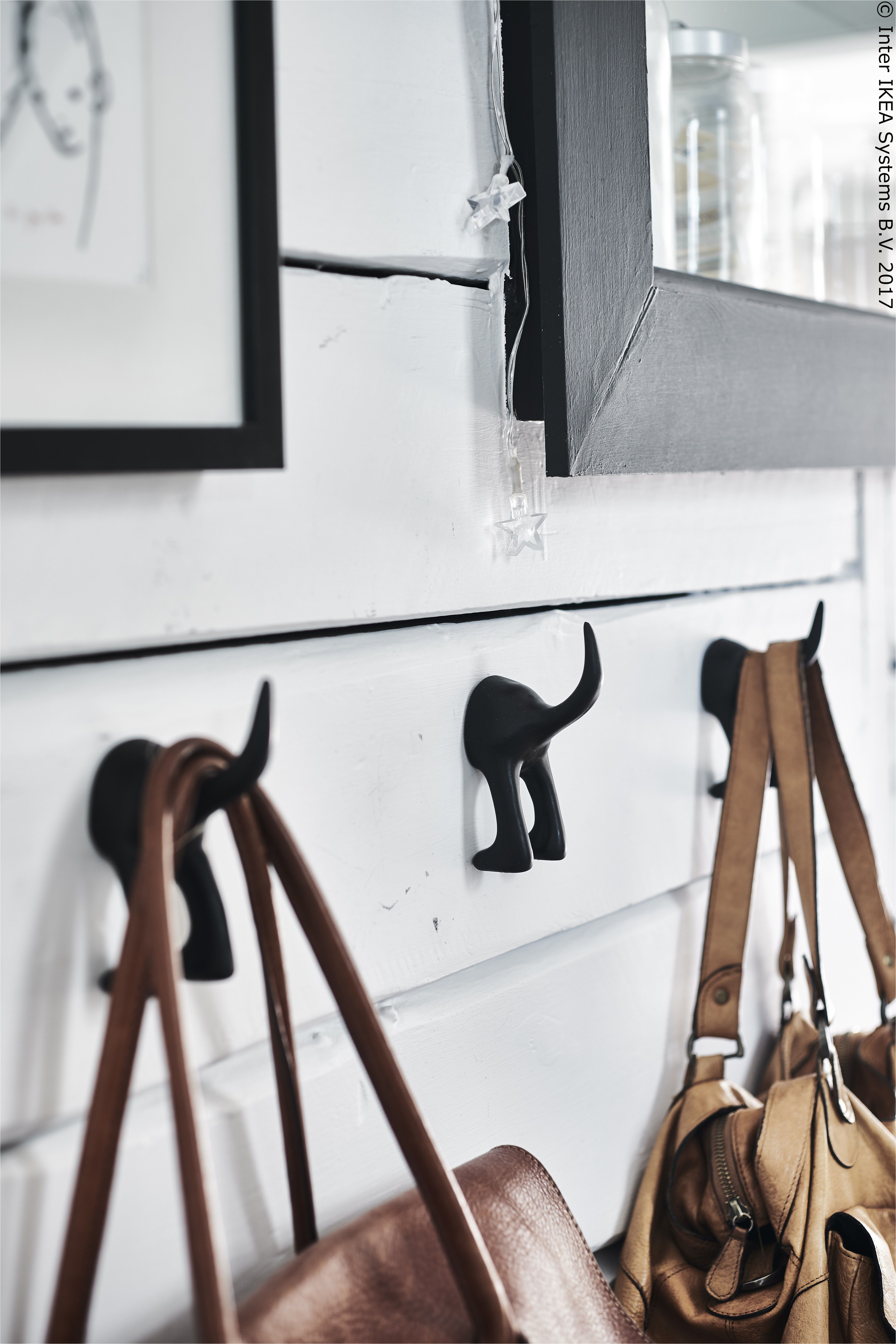 chopping boards hanging on a rail in a kitchen