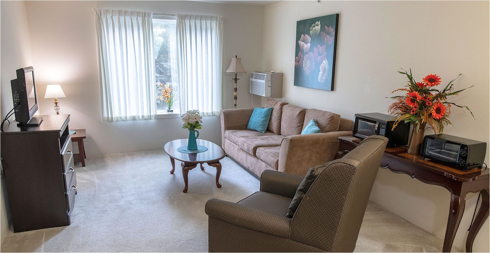 model apartment living room at jordan oaks independent senior living community