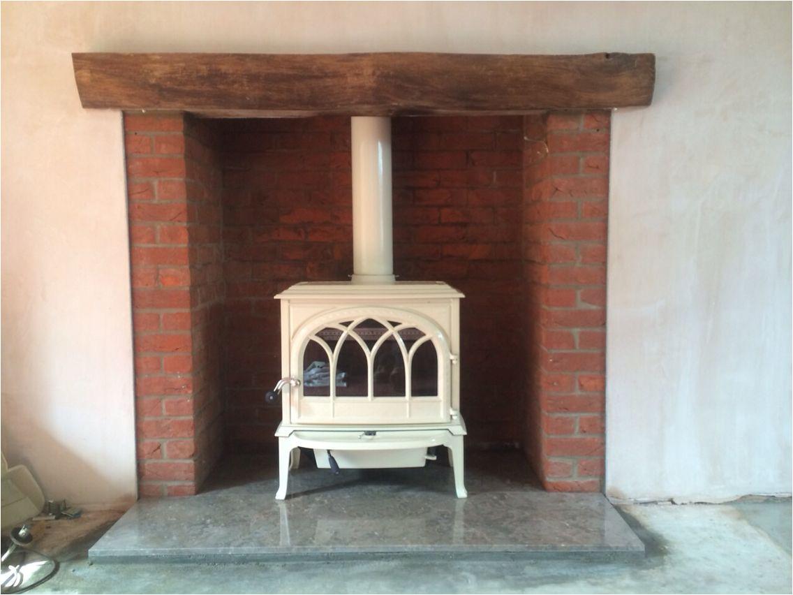 jotul f400 ivory enamel wood stove on coffee coloured hearth