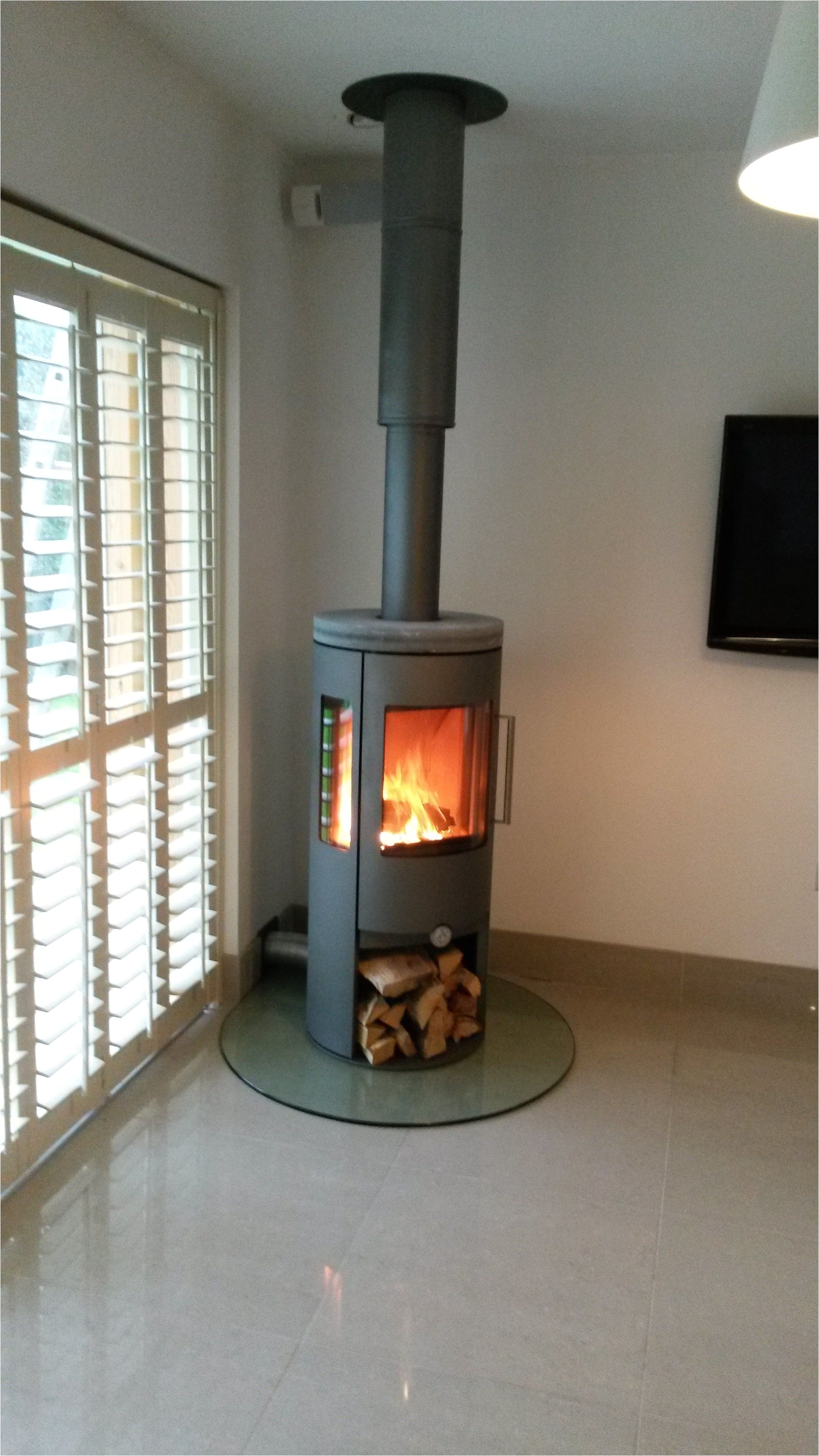 dan skan nuro 120 with side glass log store and soapstone top plate plate glass hearth