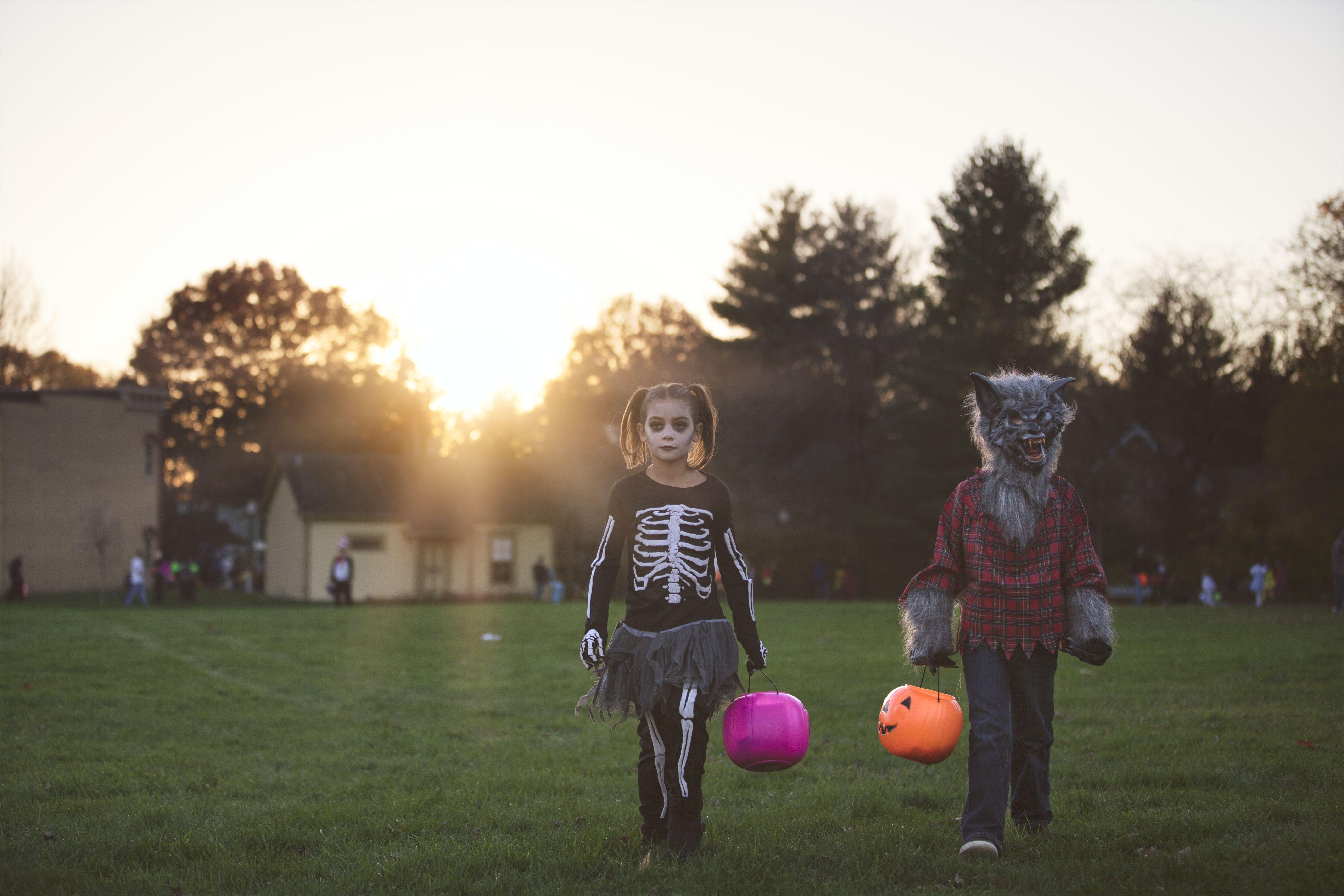 costumed children walking across grassy field 522825703 5a28c2b99e94270037c09613 jpg