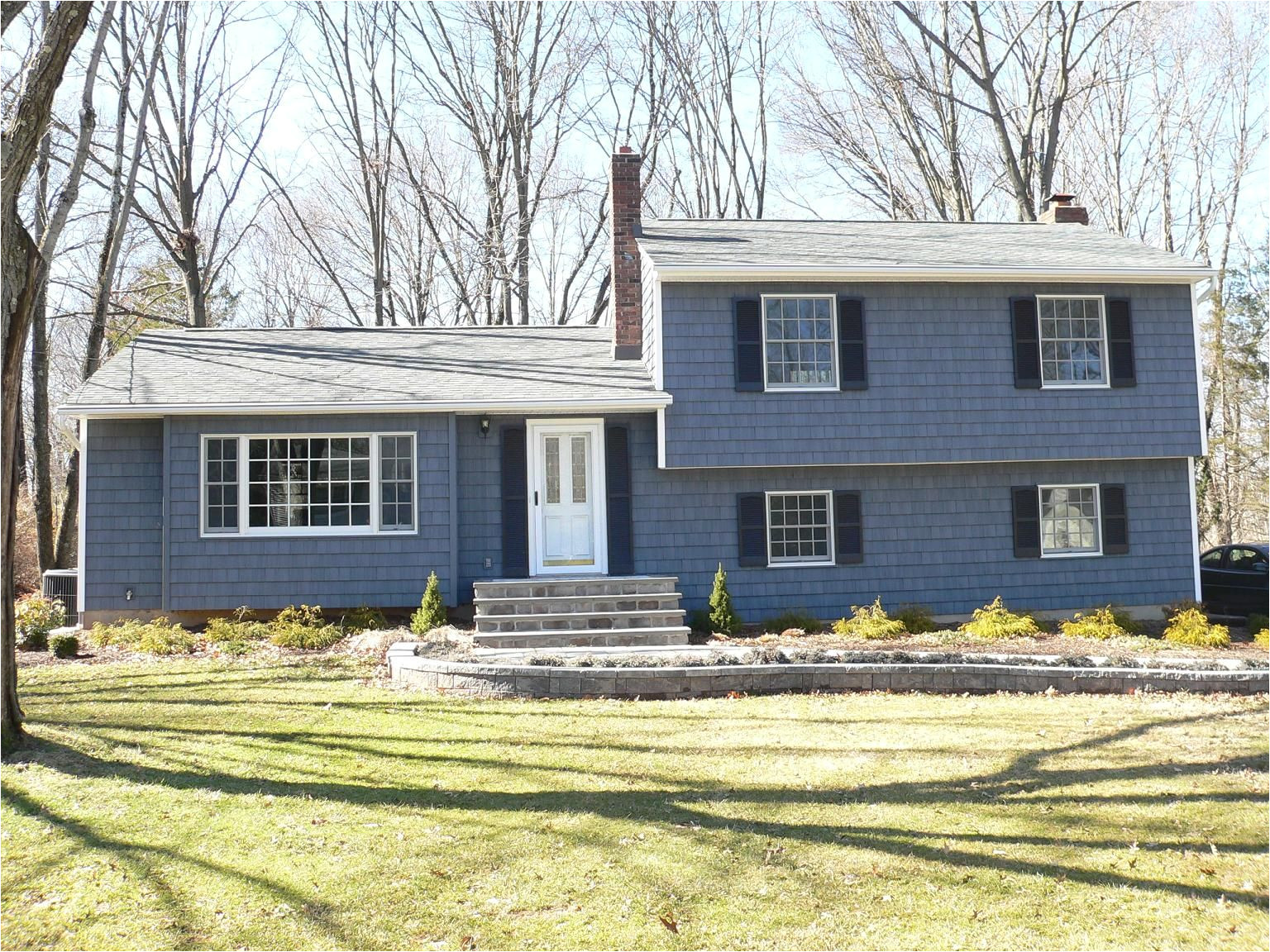 vinyl siding louvered black shutters thermatru smooth star front entry door new masonry porch bluestone treads cultured stone risers concrete slab