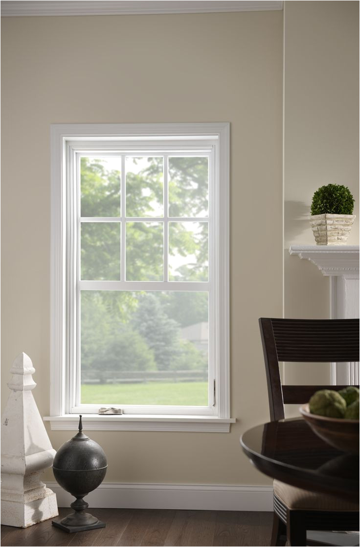 single hung window with grids increase natural lighting through a beautiful frame pair white