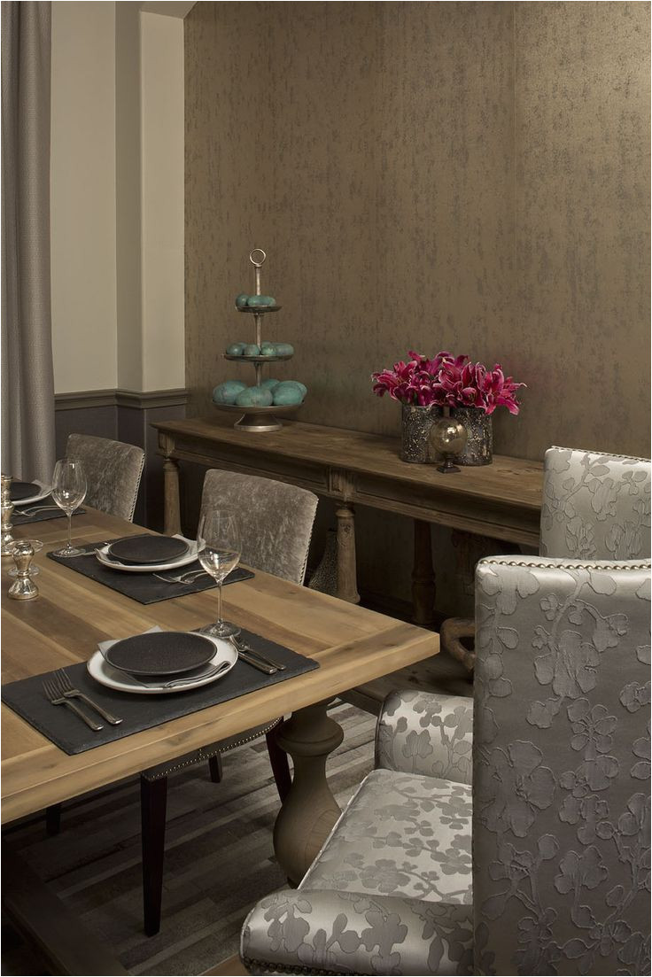 the combination of wood fabric and metals add textural interest to the space both soft and hard materials are used from the soft tone on tone floral