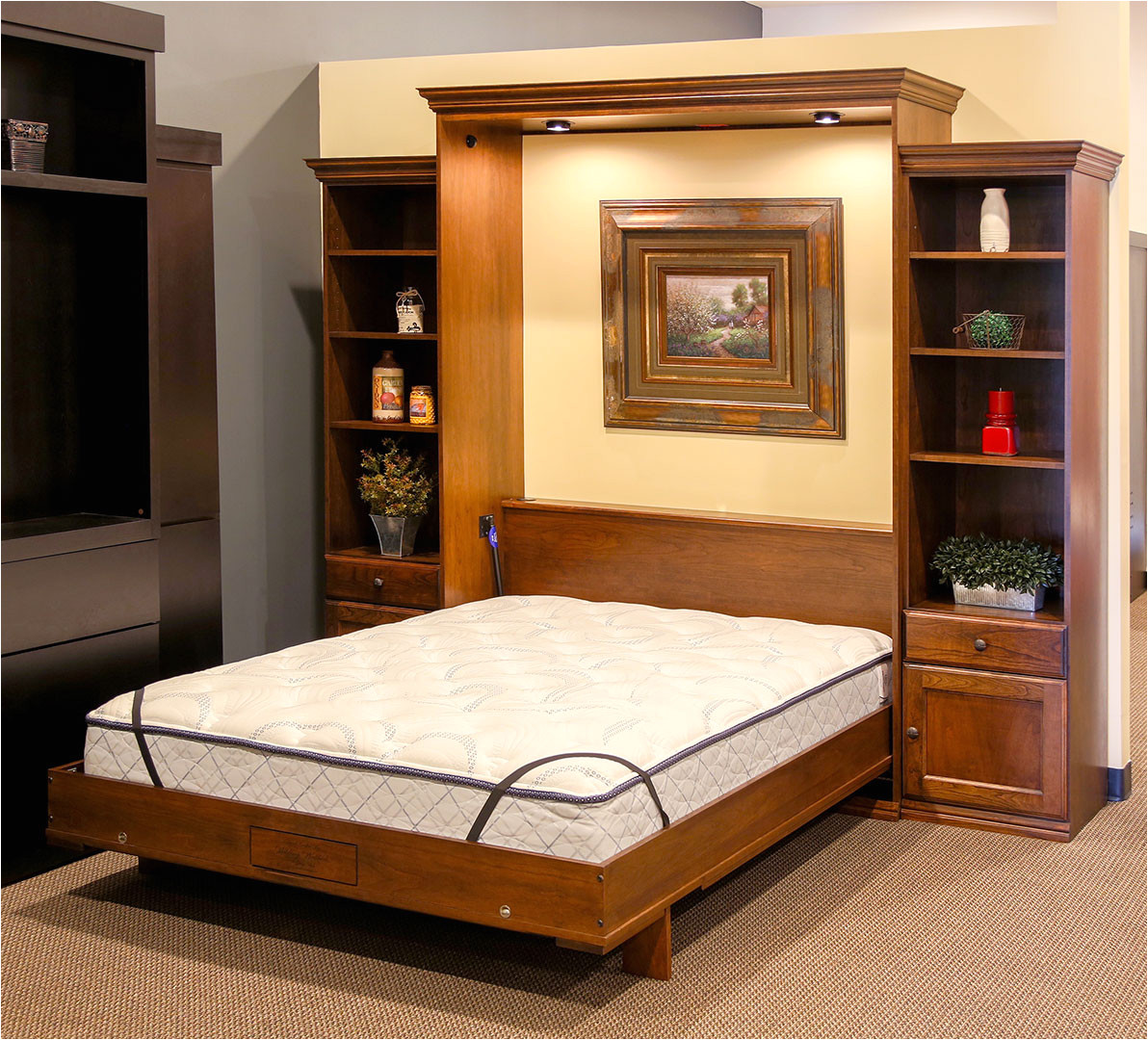 as you enter the back section of the store you ll find our extremely popular disappearing desk bed this disappearing desk is displayed in alder wood and
