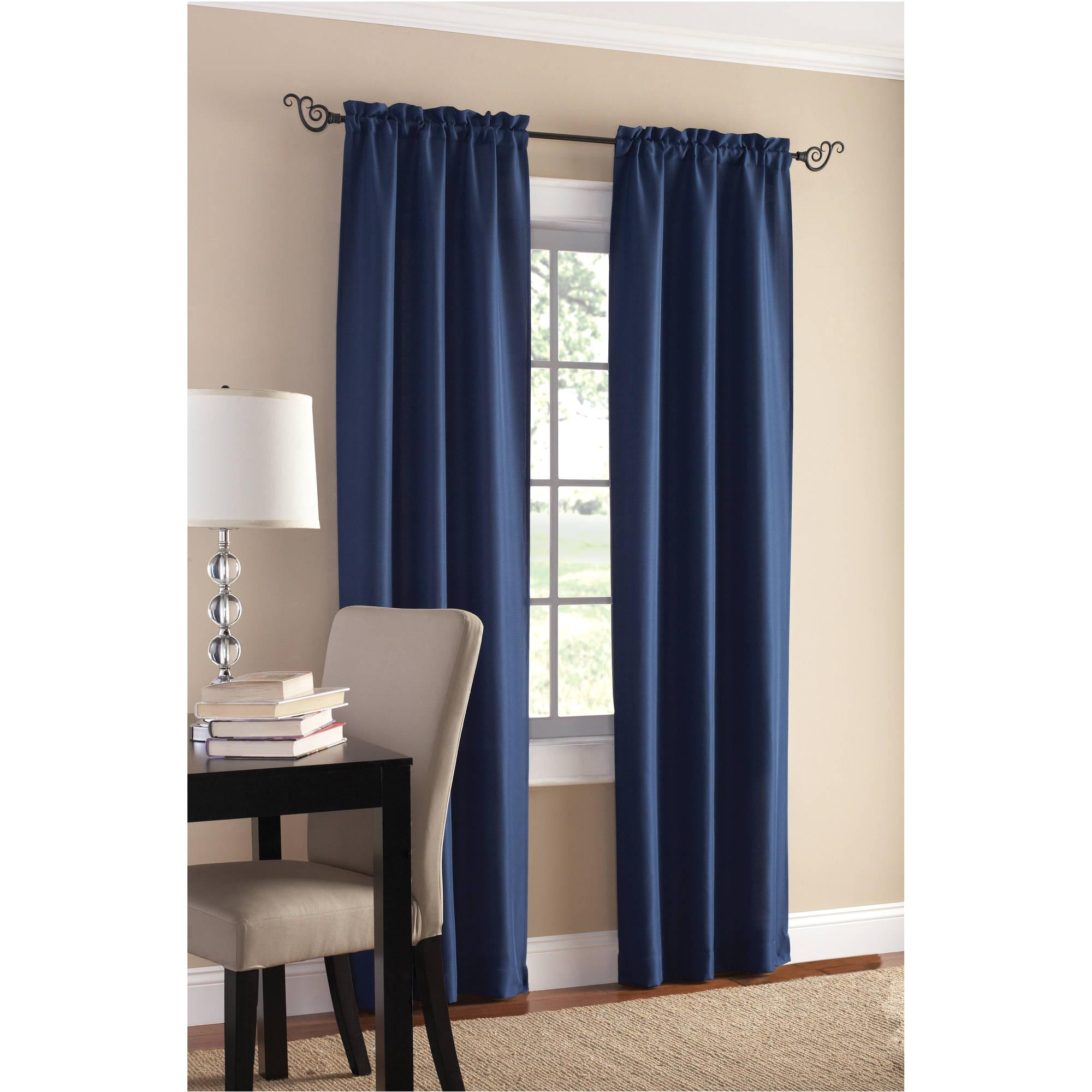 blue walmart blackout curtains with white baseboard and