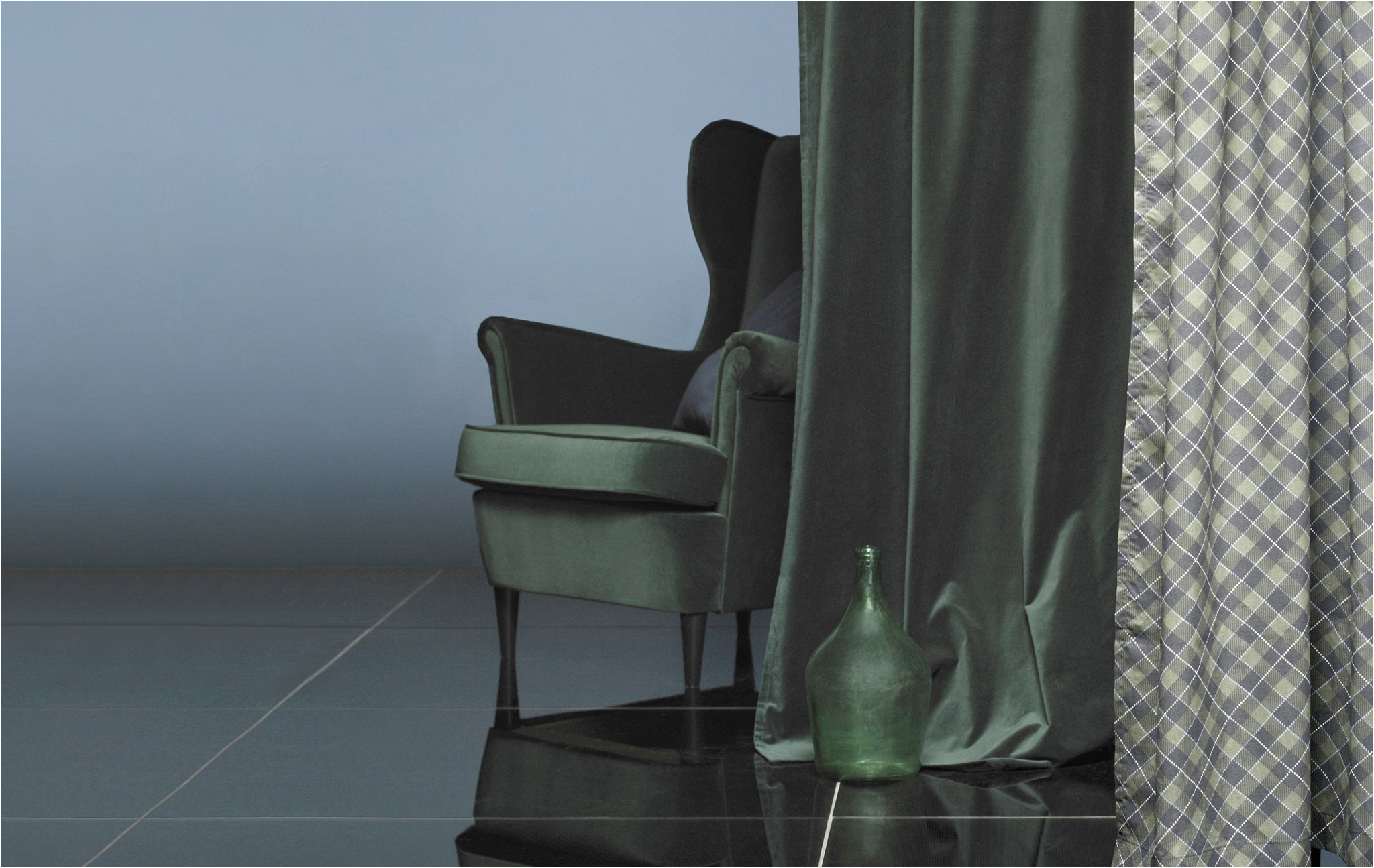 an armchair behind a curtain in matching dark green velvet