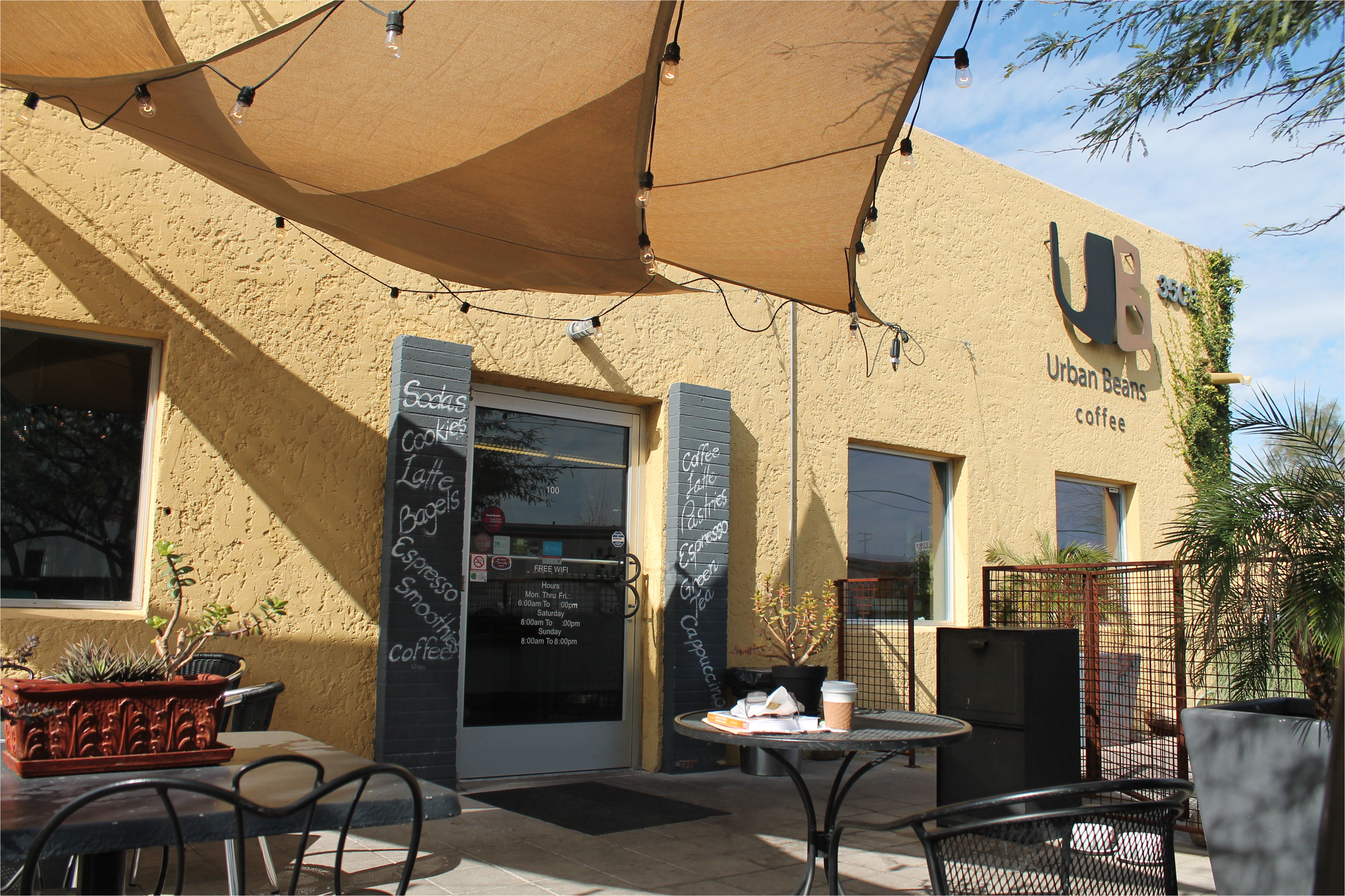 exterior view of urban beans phoenix az outdoor patio seating with tables and