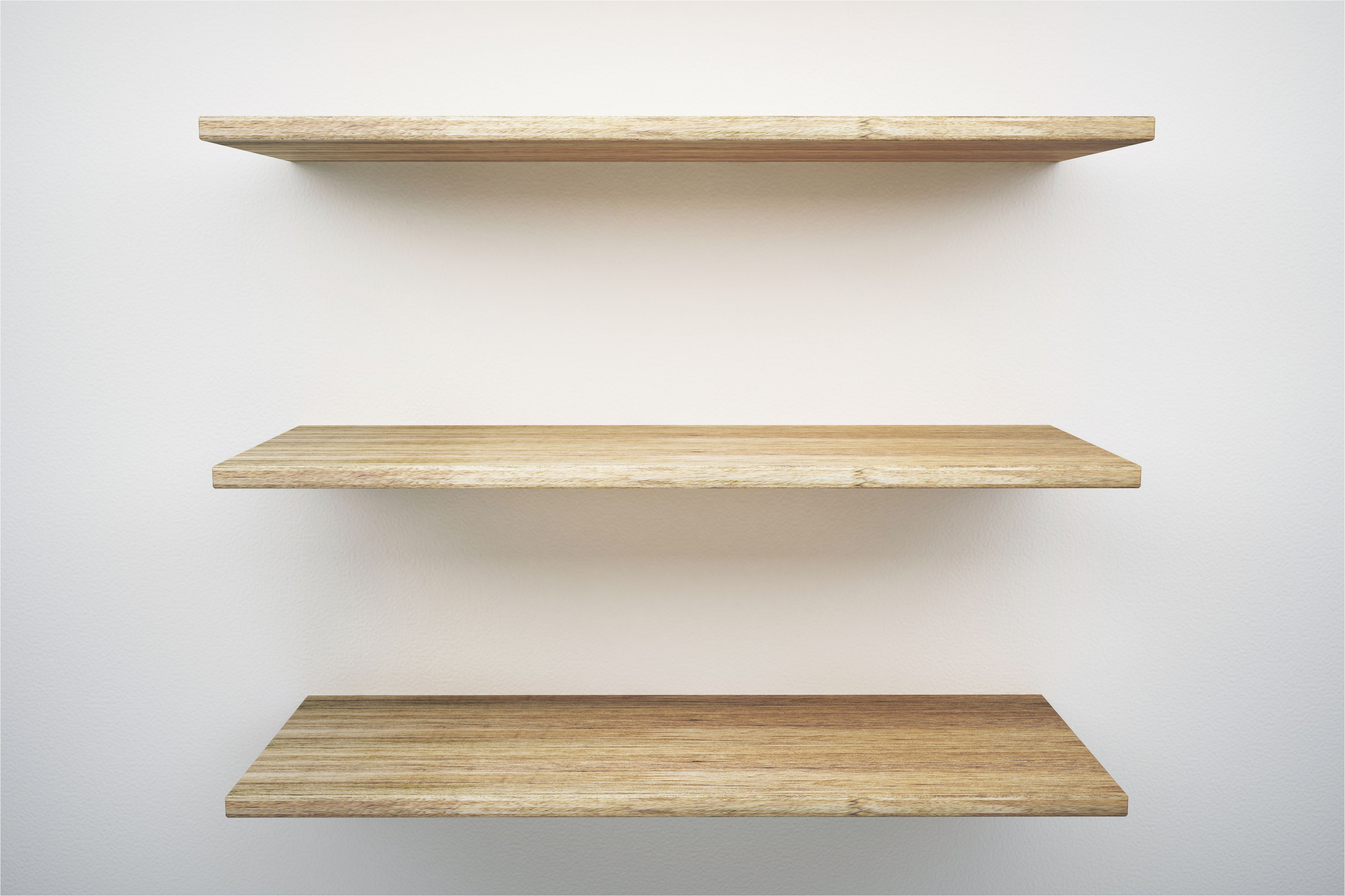 wooden shelves mounted on white wall 748563421 5a83c2aad8fdd50037f4d5dc jpg