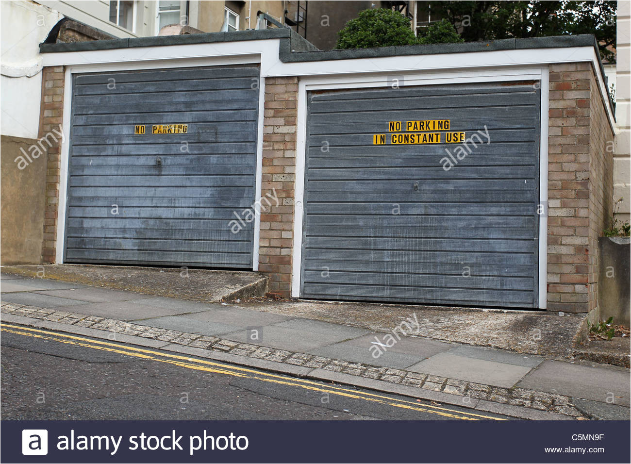 no parking garages in constant use signs on a couple of garages in brighton east