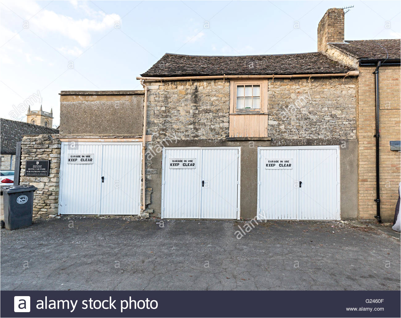 three garages with keep clear signs woodstock oxfordshire england uk stock