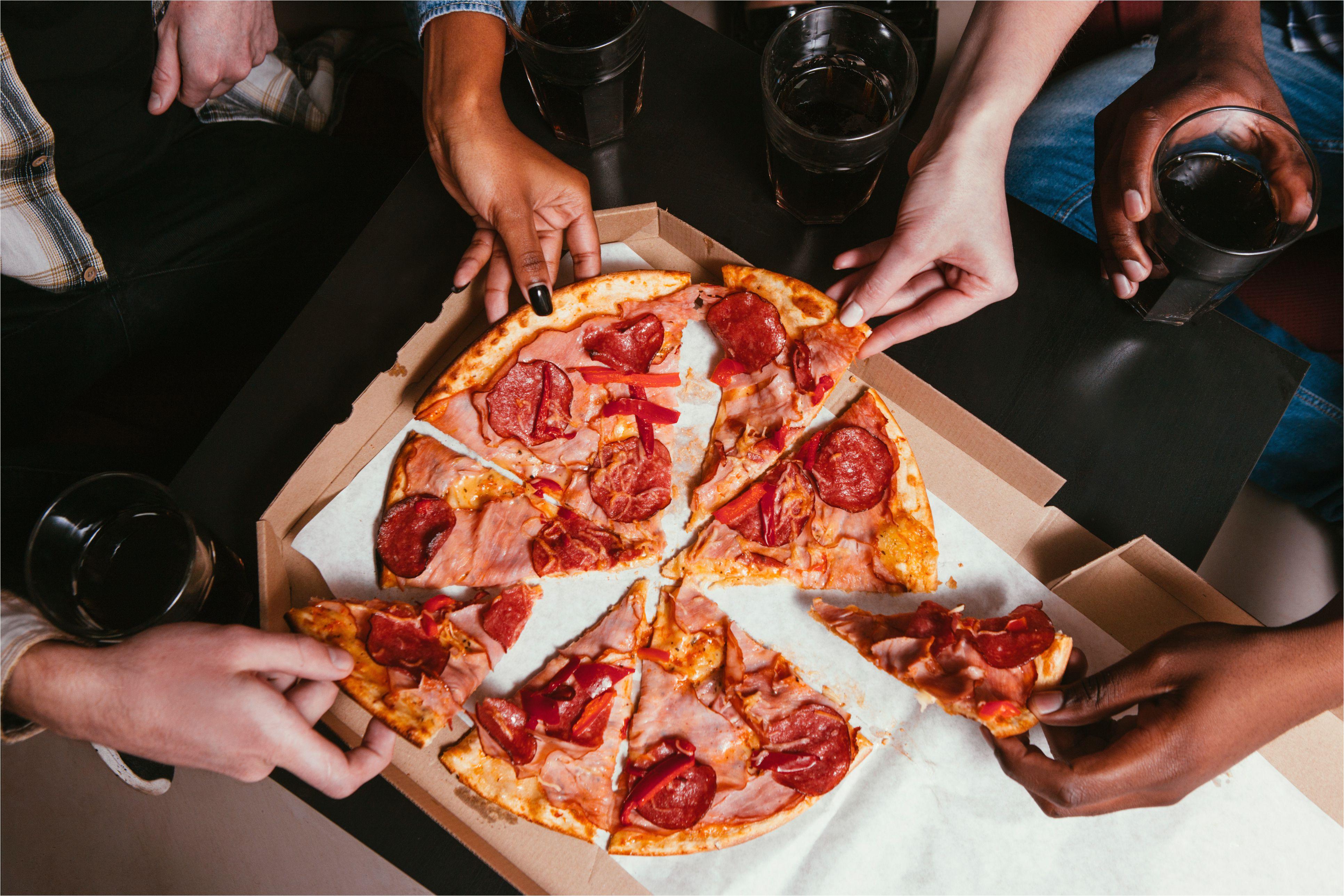 four friends company eat fresh pizza at home 680833190 5aa212418023b90037fefac0 jpg