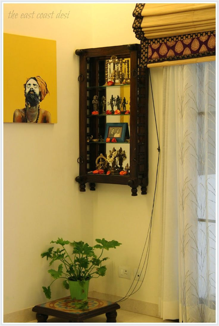 a section of the dining room has been dedicated as the pooja corner an antique
