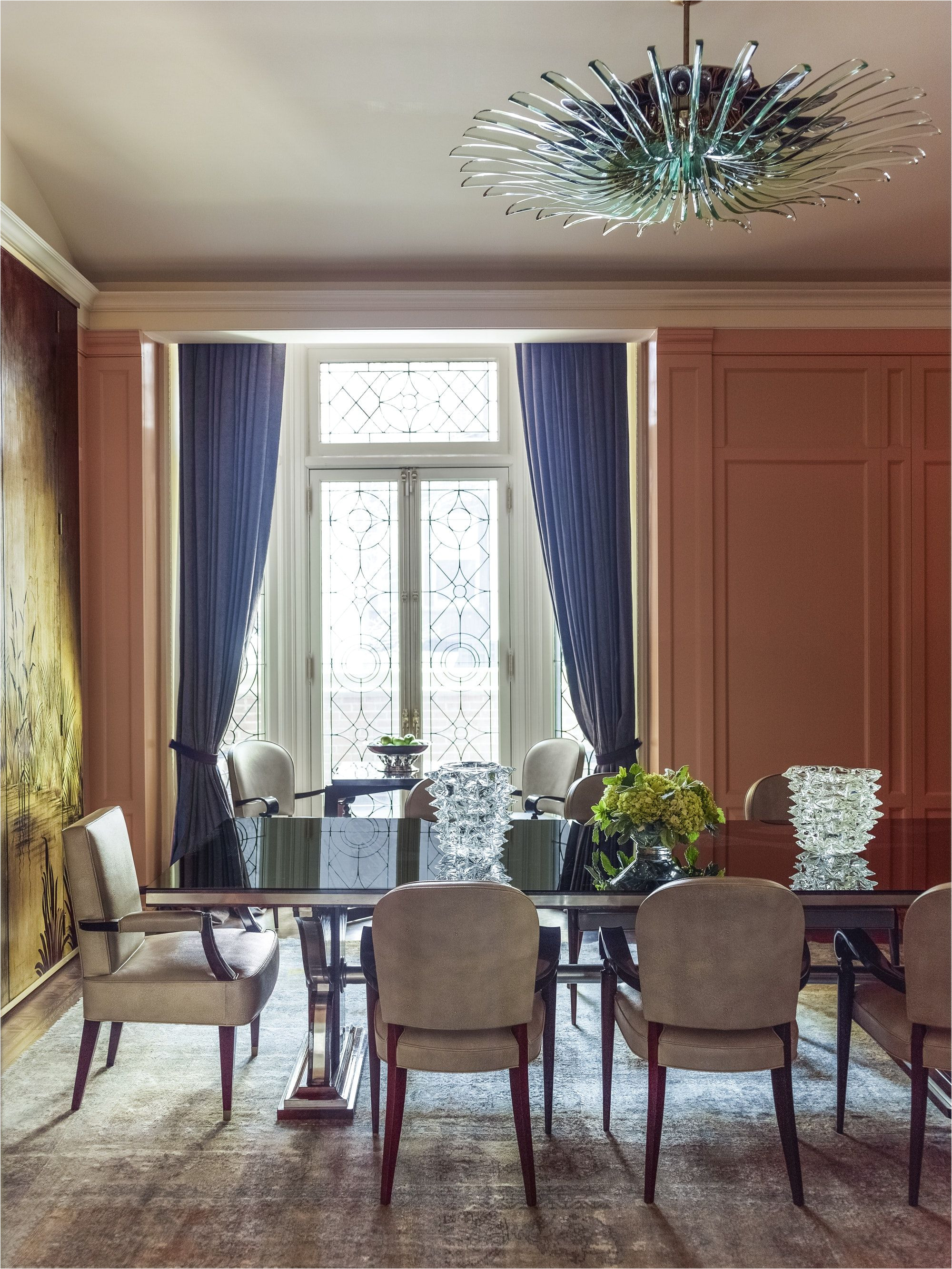 one focal point in this formal dining room is a green glass chandelier by max ingrand