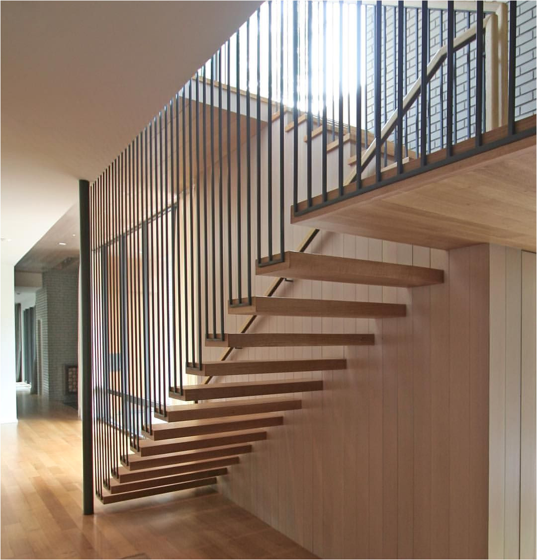 bluffview residence stair tensioned steel white oak via smitharcarchitects