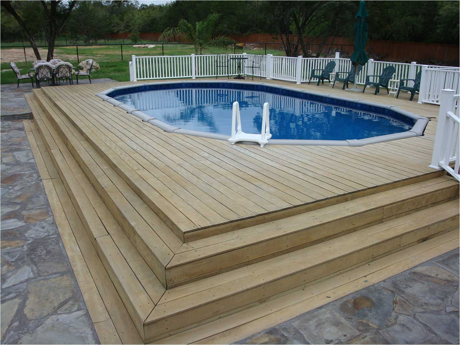 this simple pool has easily become part of the patio walkout with easy accessibility and welcoming cool waters
