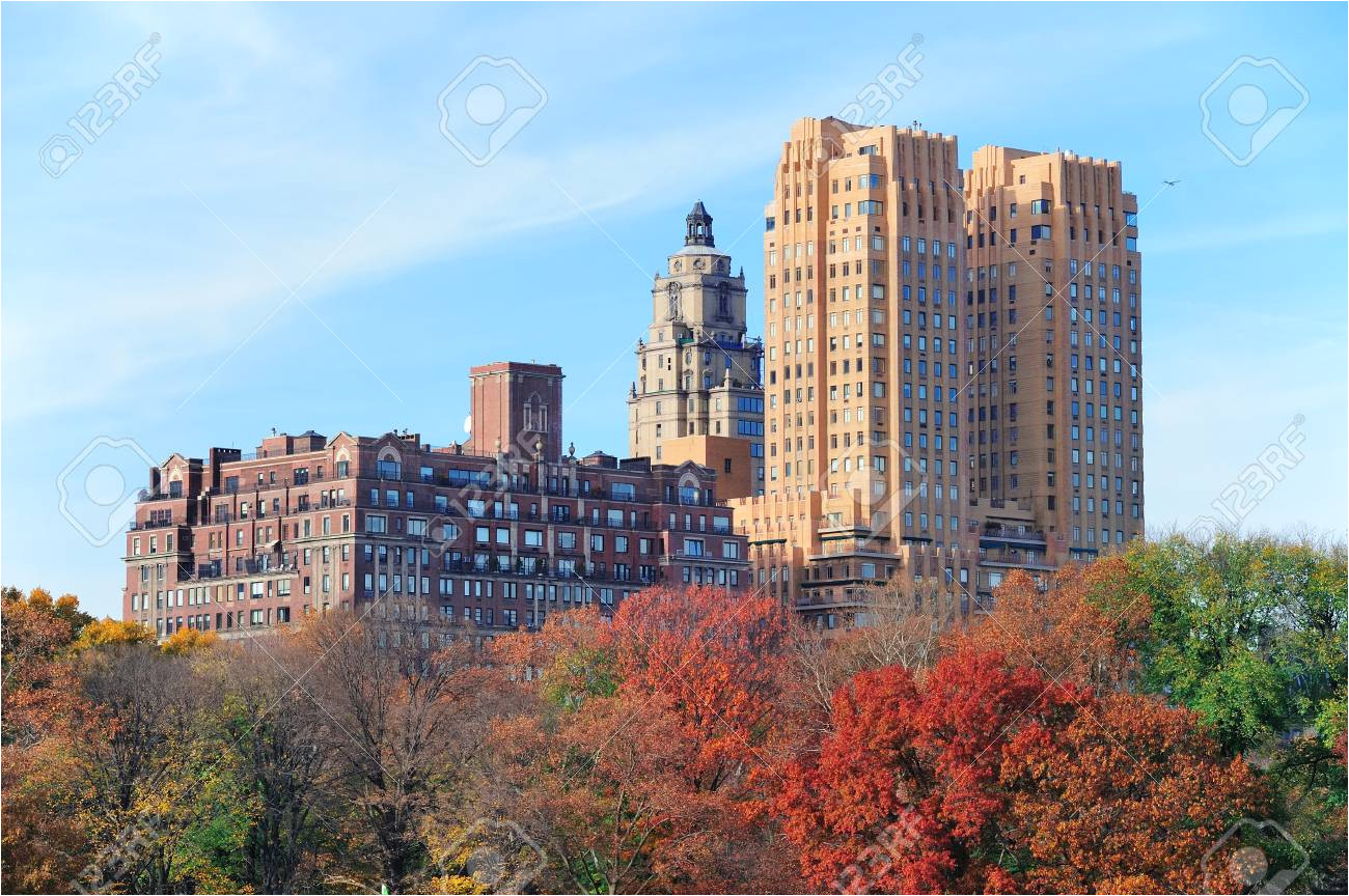 central park in new york city manhattan midtown in autumn with colorful foliage and historical buildings