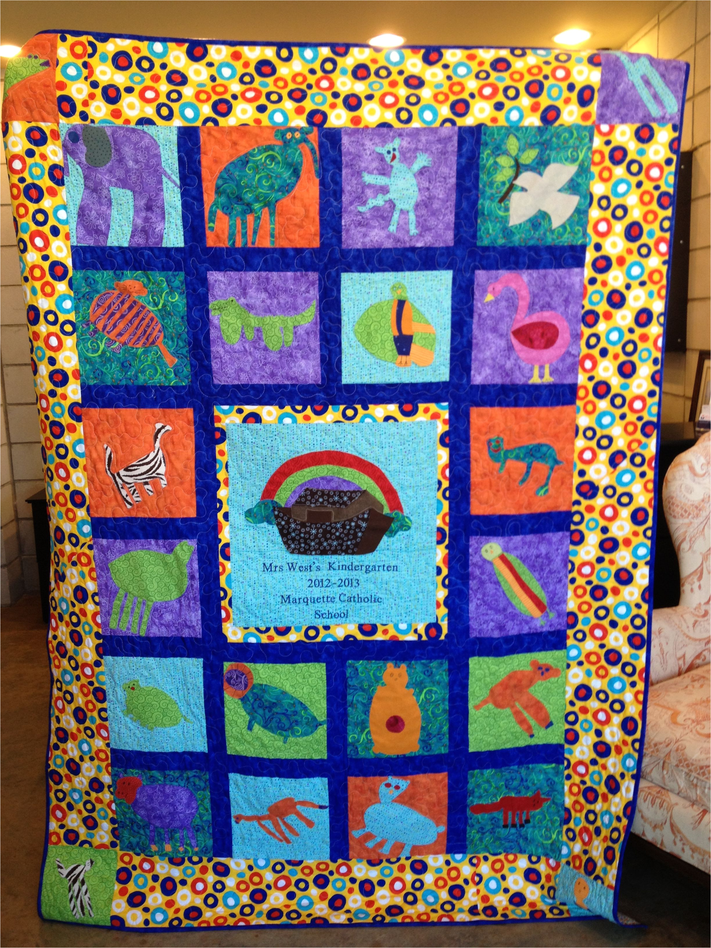noah s ark quilt for the kindergarten class auction project each child draws a different animal which is cut out of cloth and surrounds the ark