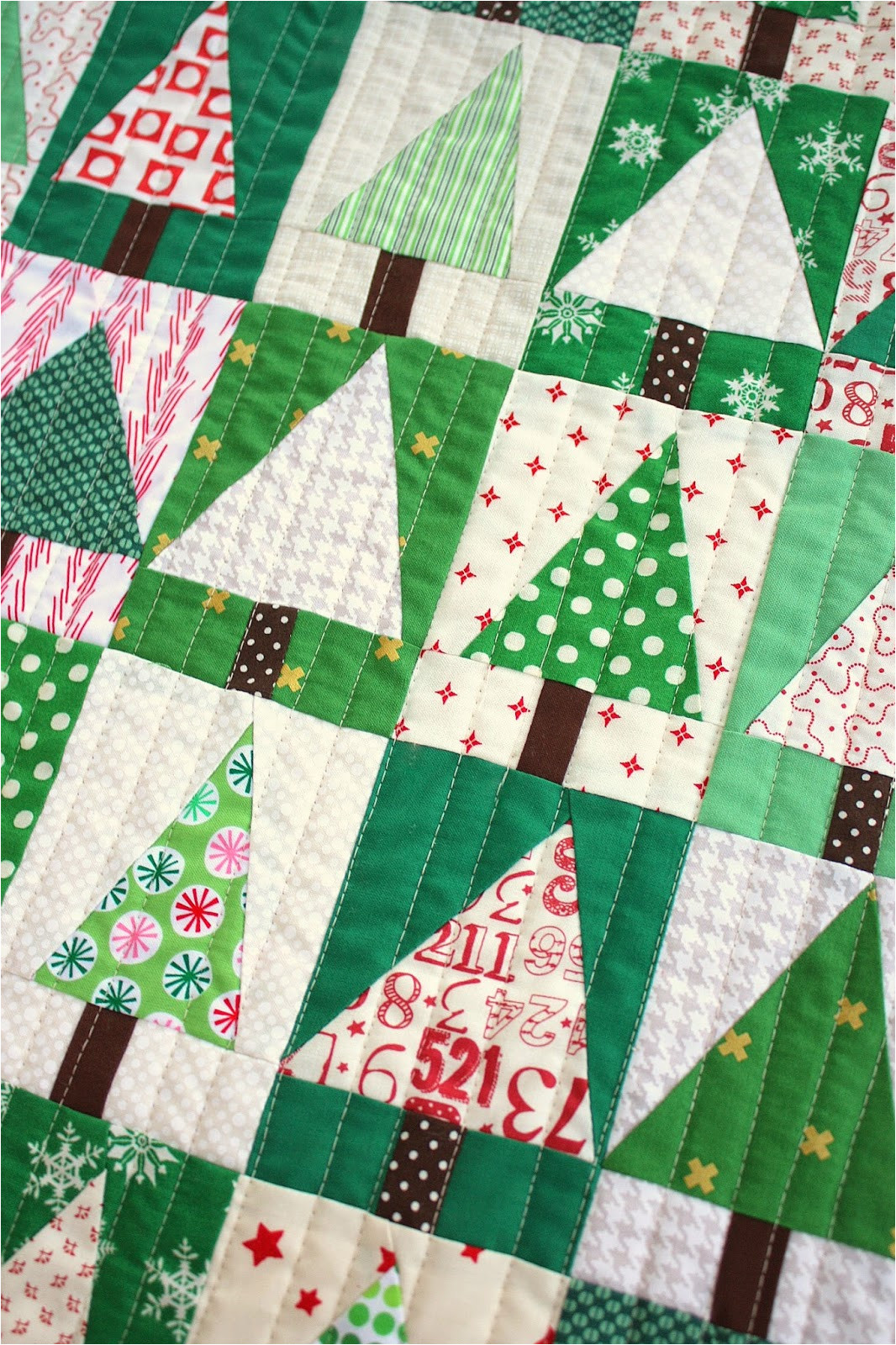 i used a red micro dot as the binding for this quilt to give a tiny bit more red to the design i purposely made the binding small though