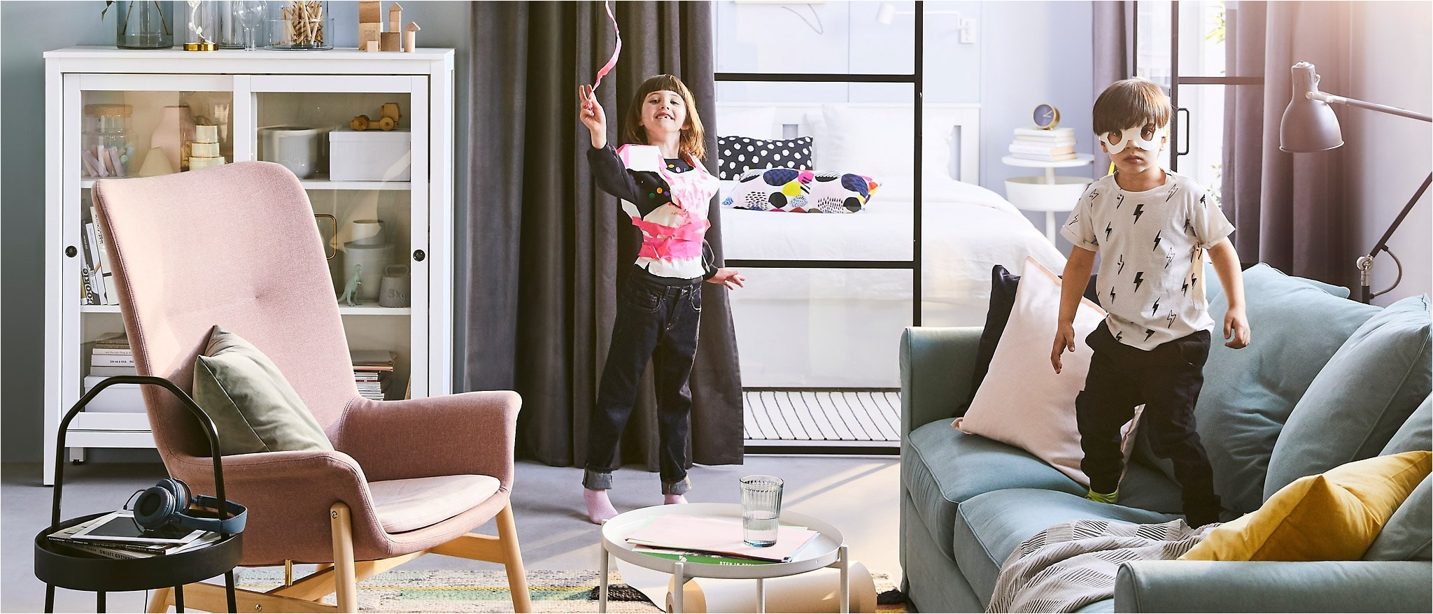the 2019 ikea catalogue cover features two children playing in a living room they can