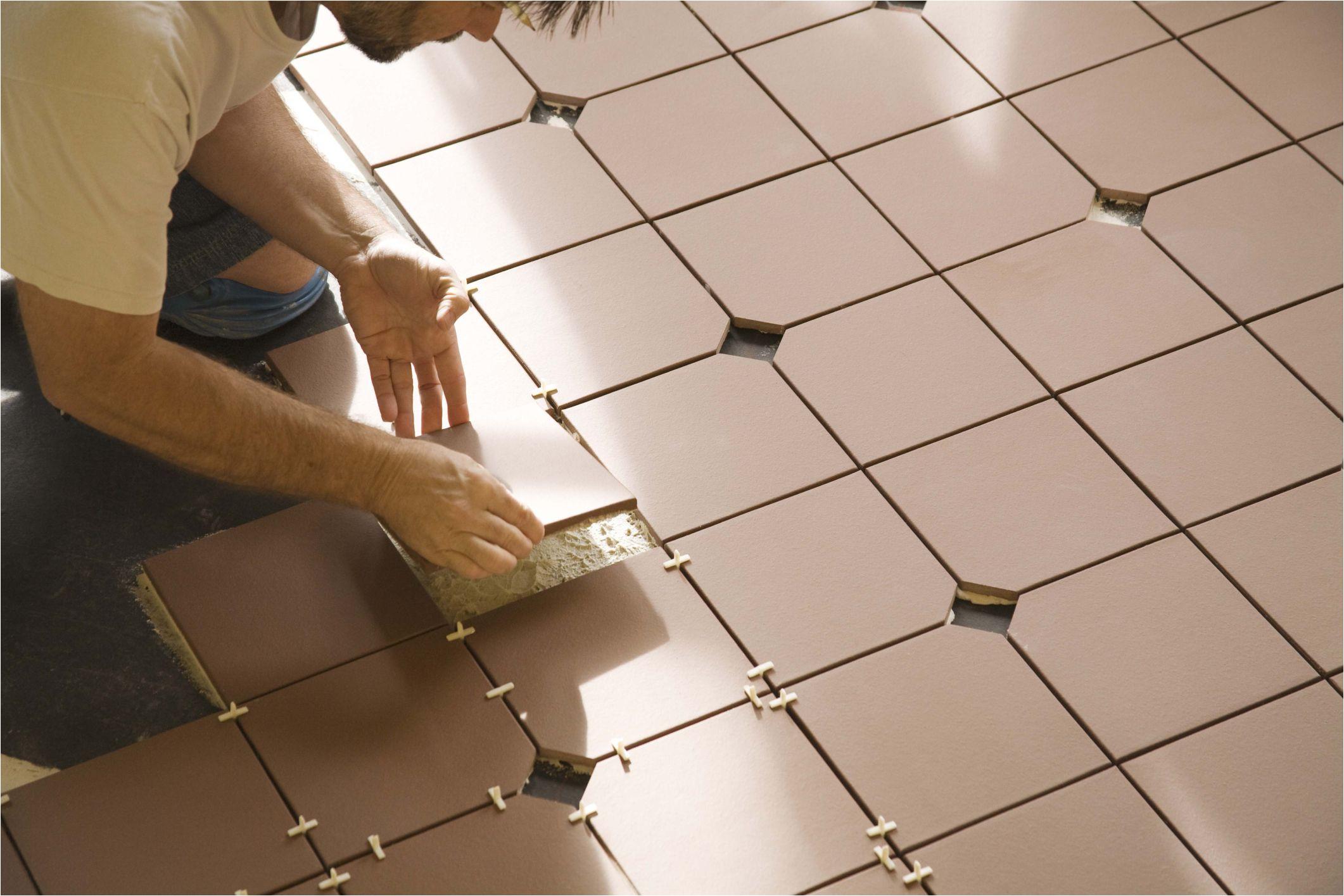 installing ceramic floor tile 86464768 56a4a0555f9b58b7d0d7e391 jpg