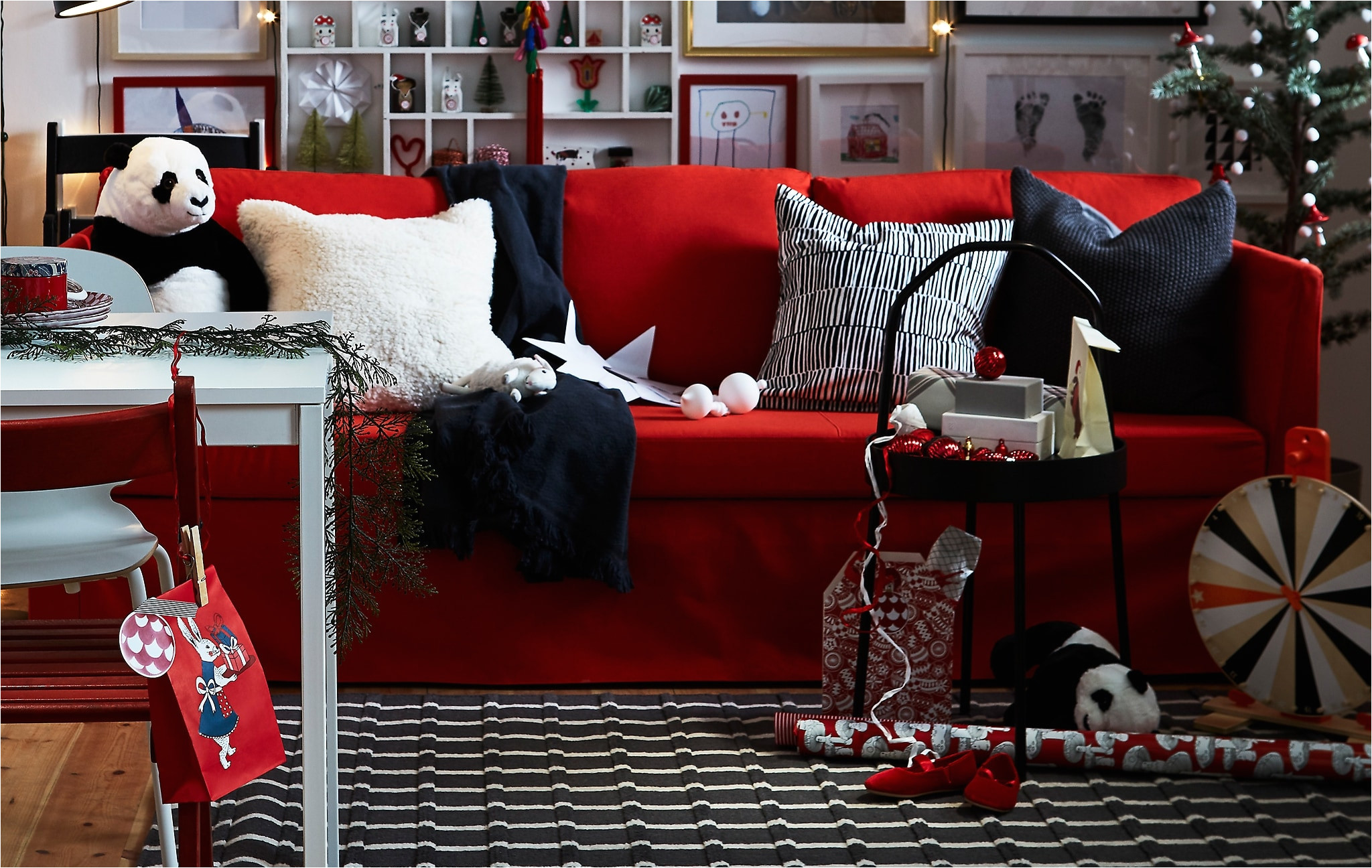 a red black and white living room with plenty of personal details and flexible furniture