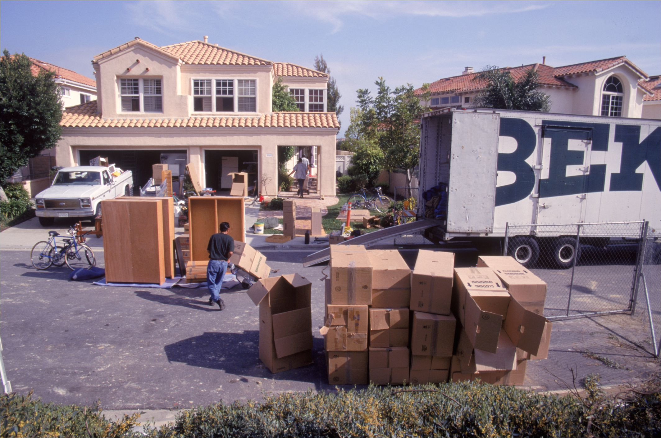 movingboxesinfrontofhome spencergrant photolibrary 56a1dee23df78cf7726f5eec jpg