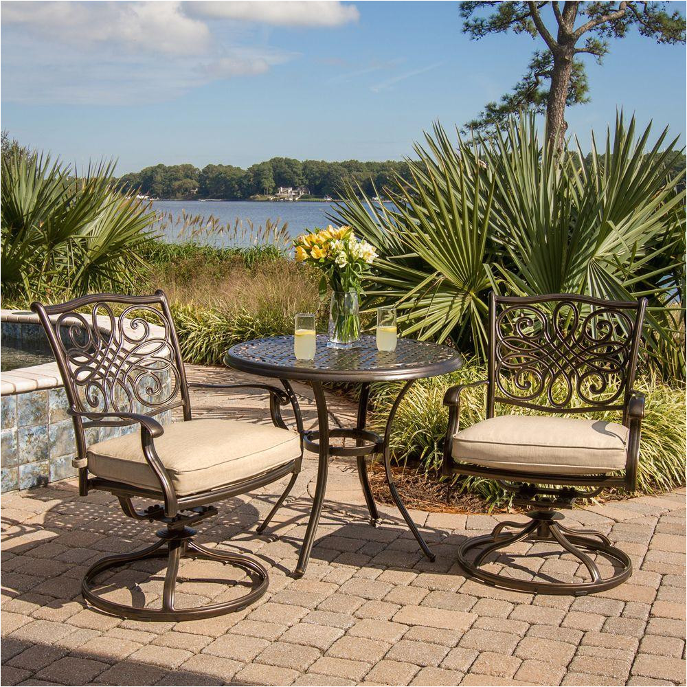 traditions 3 piece patio bistro set with 2 cast aluminum swivel rockers with beige