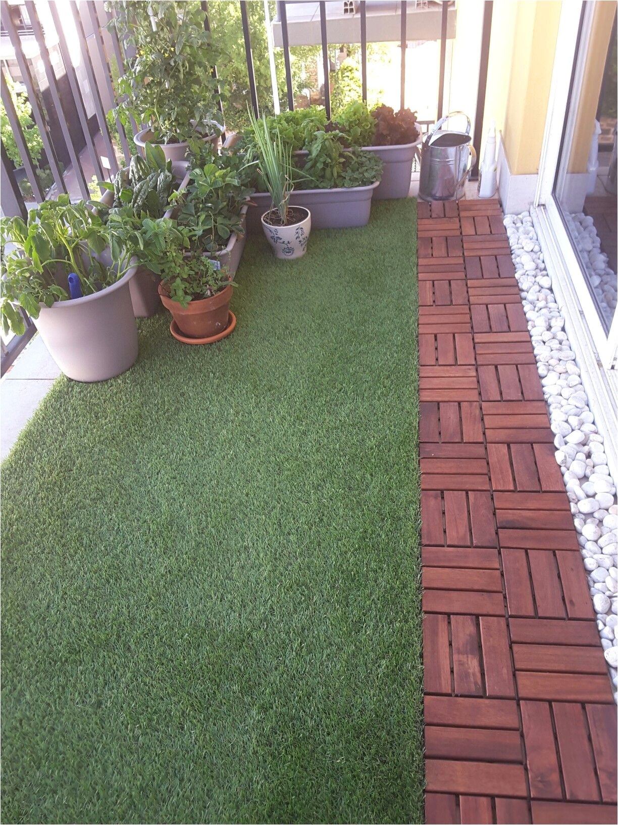 balcony with artificial grass decking and plants