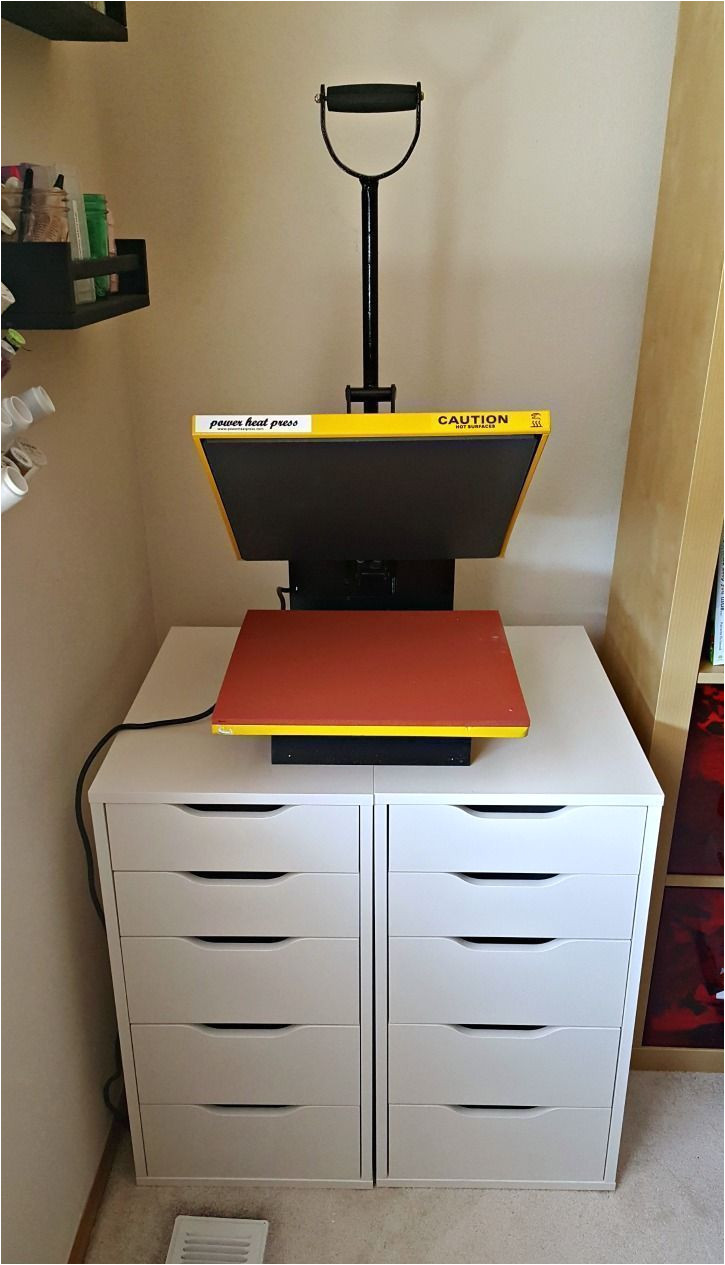 the ikea alex drawers are the perfect multi purpose solution for storing both vinyl and the heat press keep your craft area neat and organized