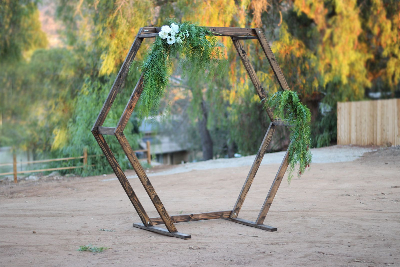 this handmade wood geometric ceremony arch rental item is the perfect accent to any event circle ceremony arch for rent in san diego and southern
