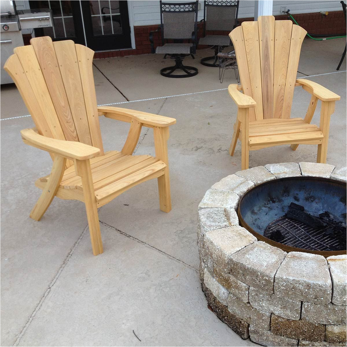this adirondack chair and matching love seat are designed for outdoor comfort they re designed for easy assembly so that a novice can build them and you