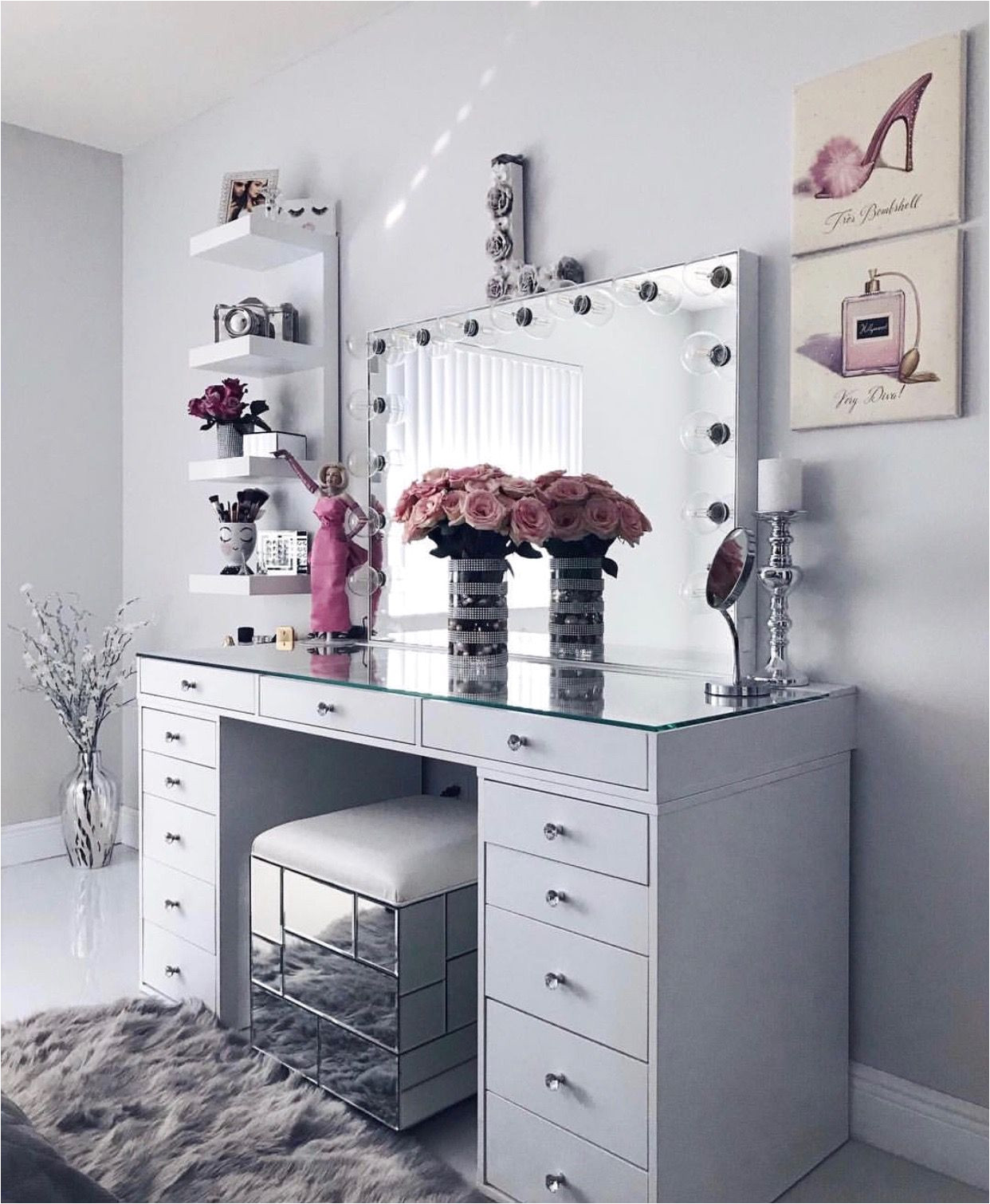 white clean sleek vanity decor paintings flowers glass furniture perfect idea for smaller apartments