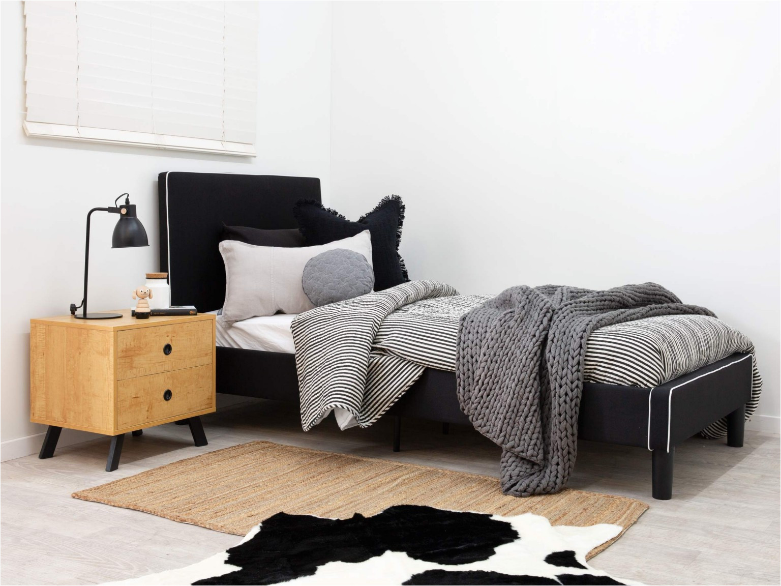 mocka darcy bed black with kirra bedside table piper rug faux cowhide rug