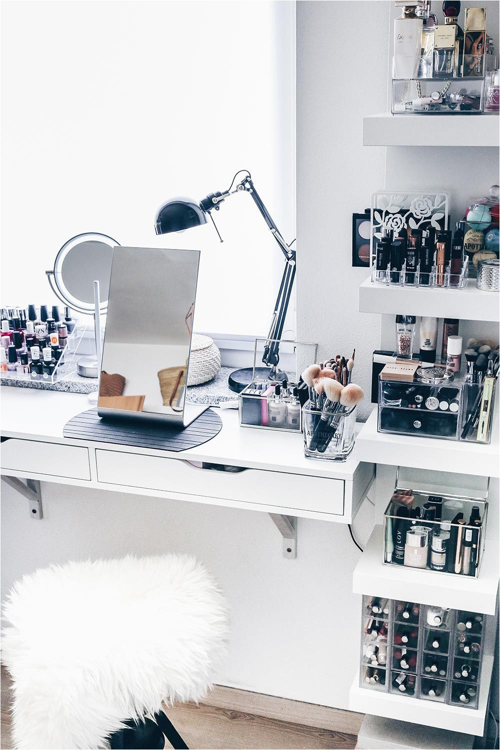 the ikea storage things on the wall you then put just a bunch of acrylic things from the dollar store and fill them with makeup