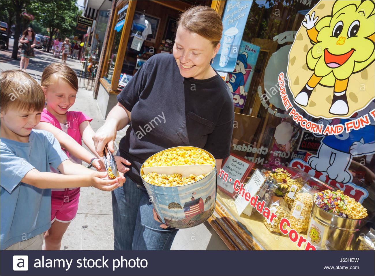 michigan traverse city front street shopping woman girl boy pop kies gourmet popcorn free sample