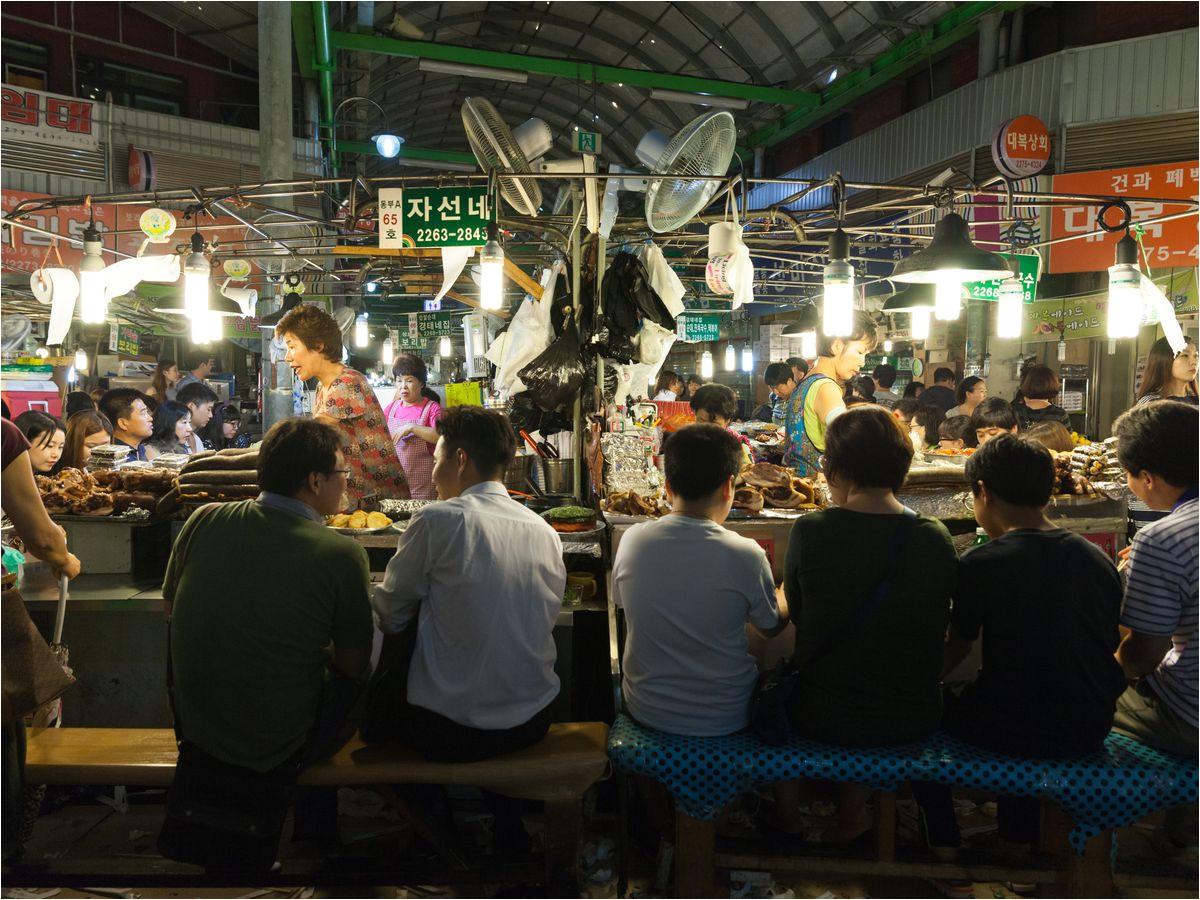 people eating at the food stalls at gwangjang street market photo by elena ermakova shutterstock