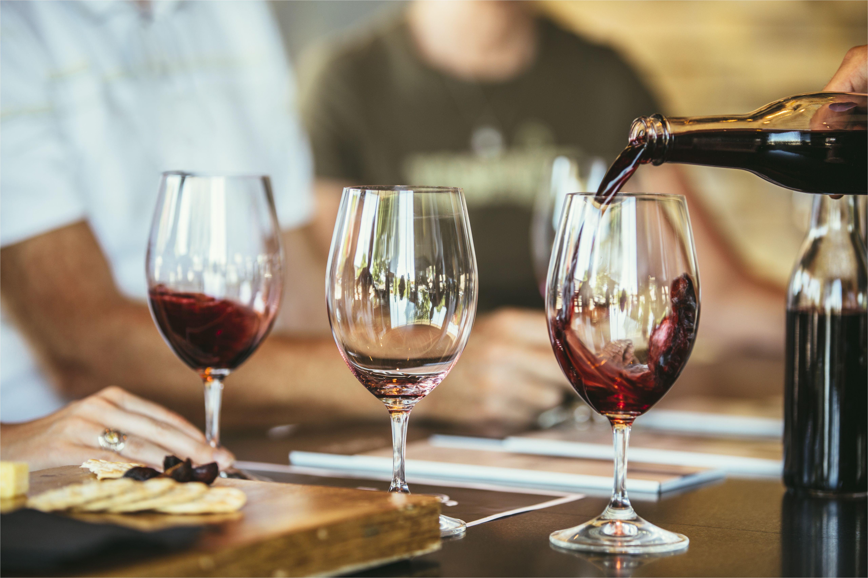 people drinking wine together in bar 514411781 59af5949845b3400118e8040 jpg