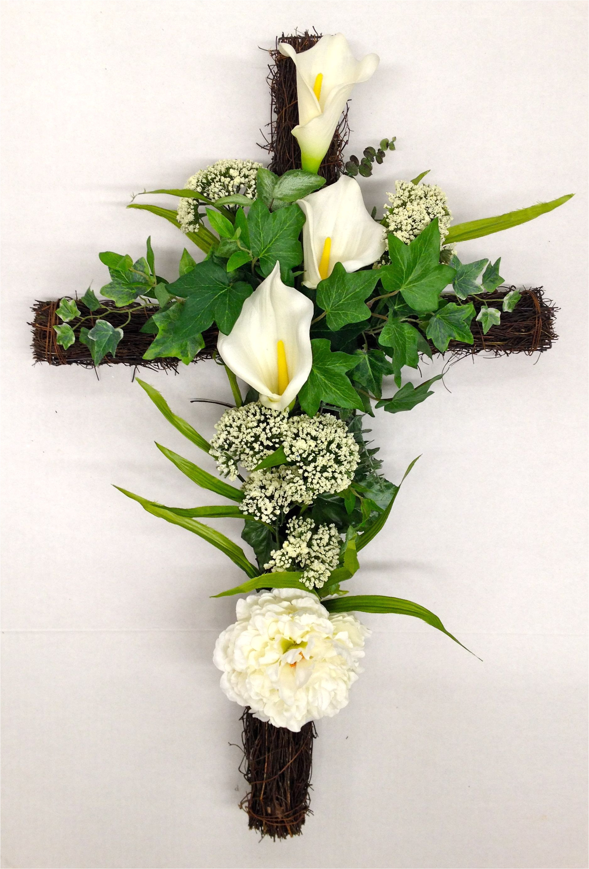 season memorial grape vine cross with white calla lilies and wild powdery white flowering plumes
