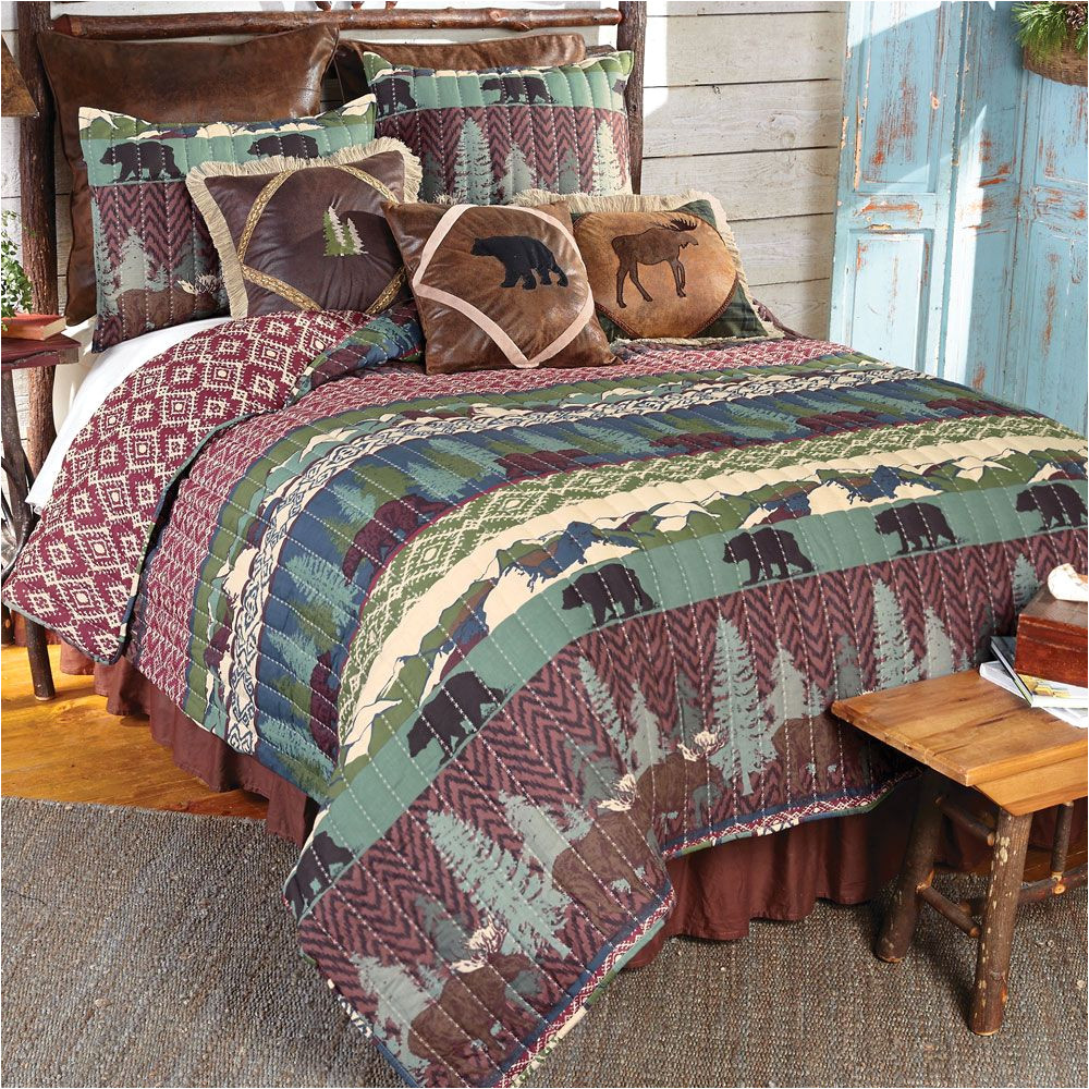 bear gulch quilt bedding collection moose bears evergreens and mountains combined with a lodge ikat print evoke the spirit of outdoor living on this