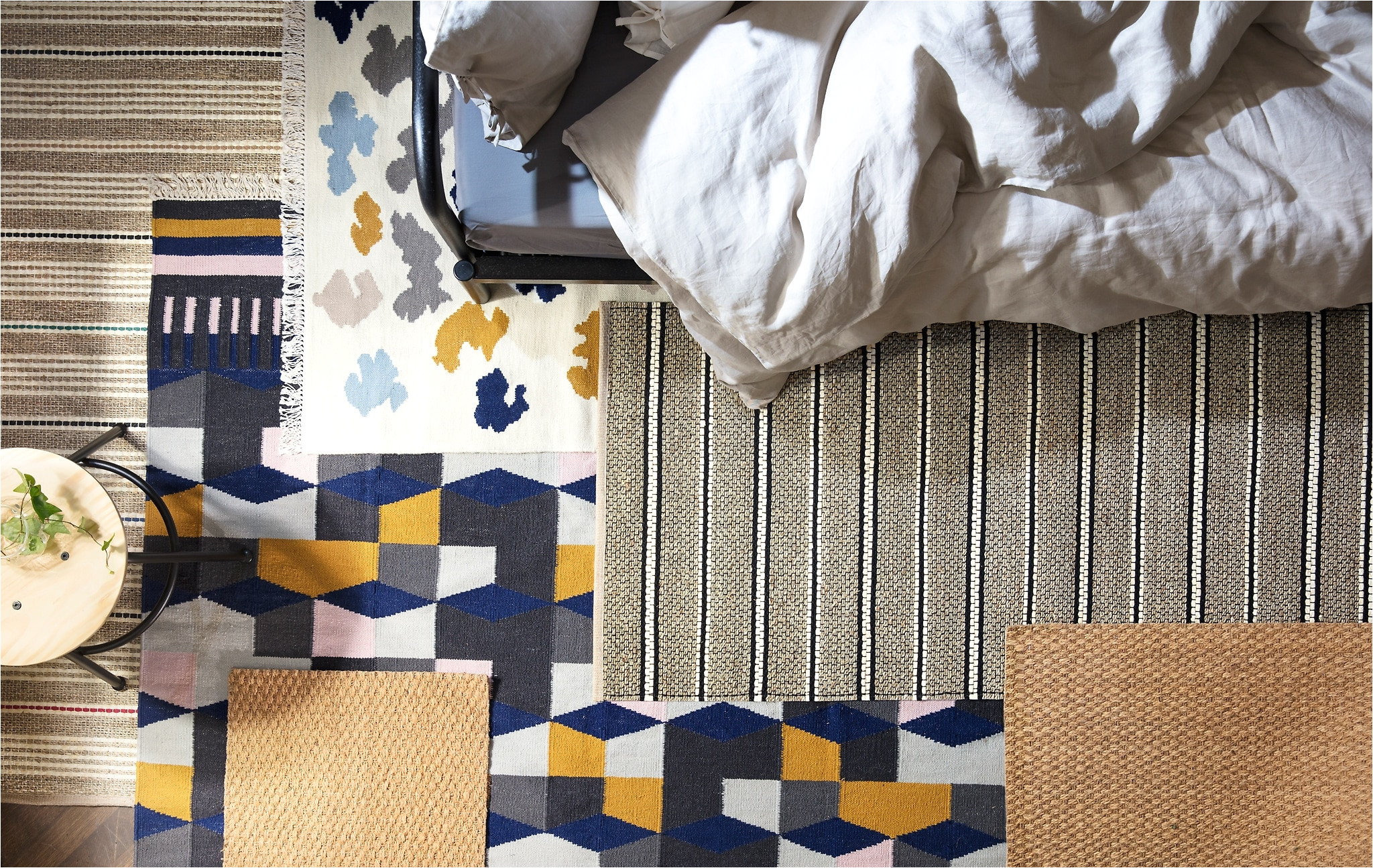 alt text create a cosier bedroom use a couple of rugs on your floor to
