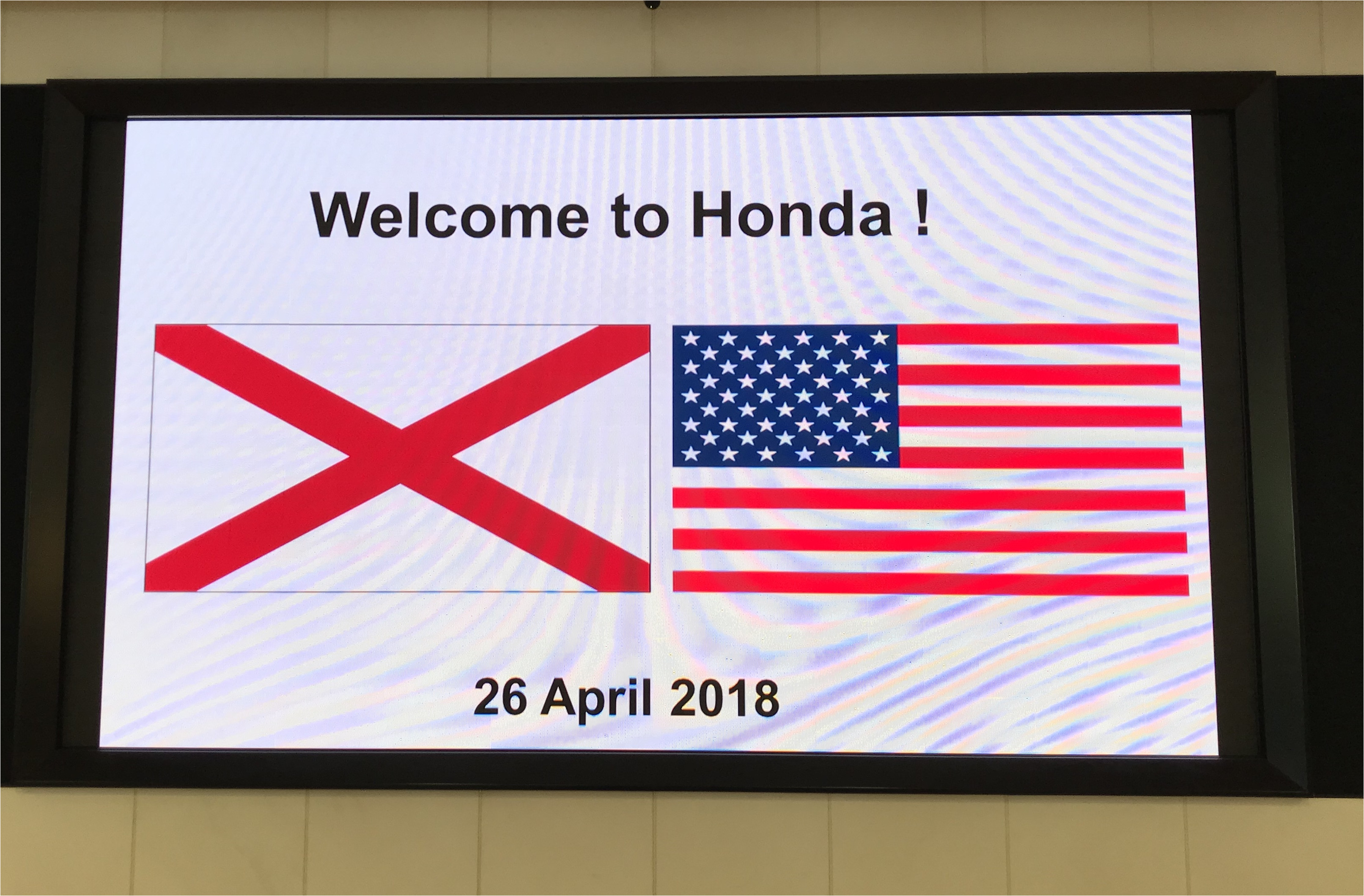 honda greets the alabama team with the alabama and u s flags