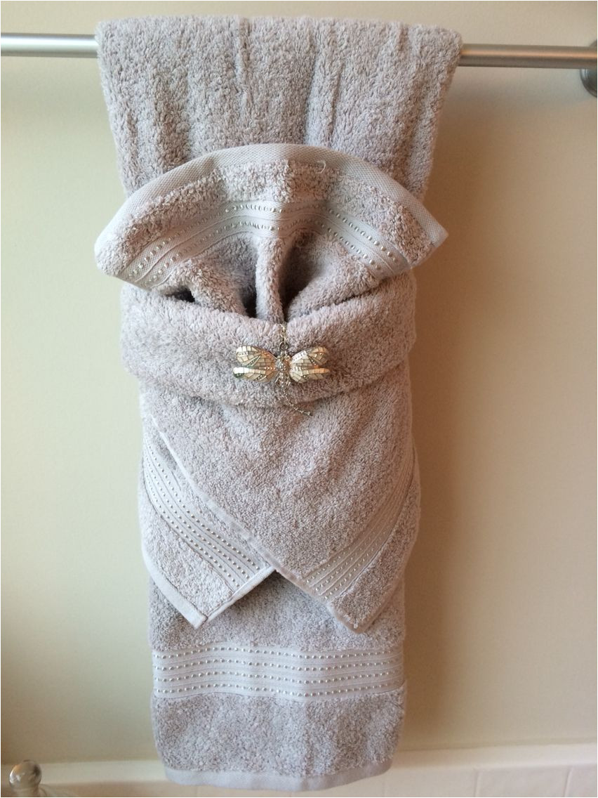 fancy towel folding with dragonfly bling more