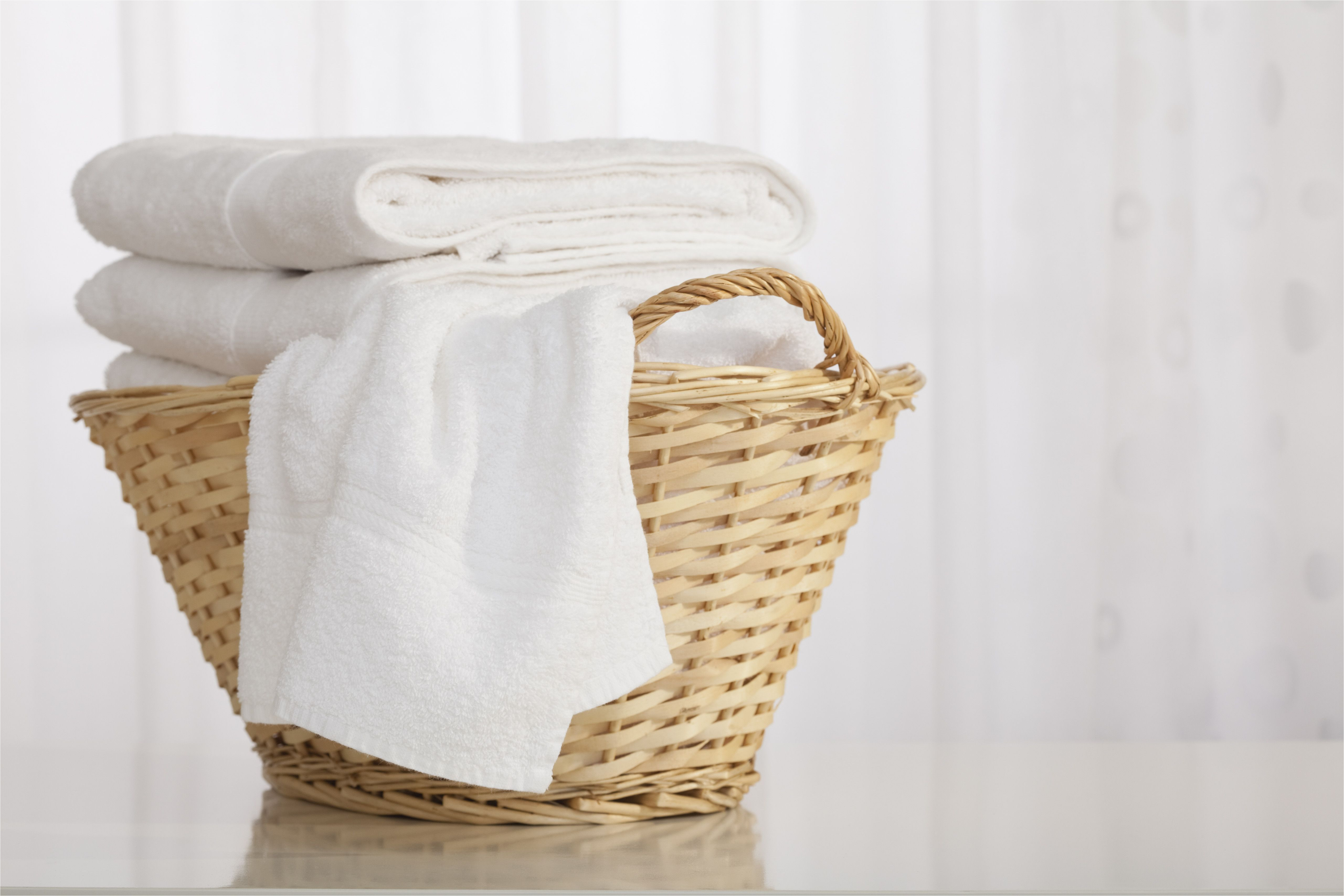 studio shot of stack of white towels in wicker basket 152892922 59d3f219054ad90010dc84c8 jpg