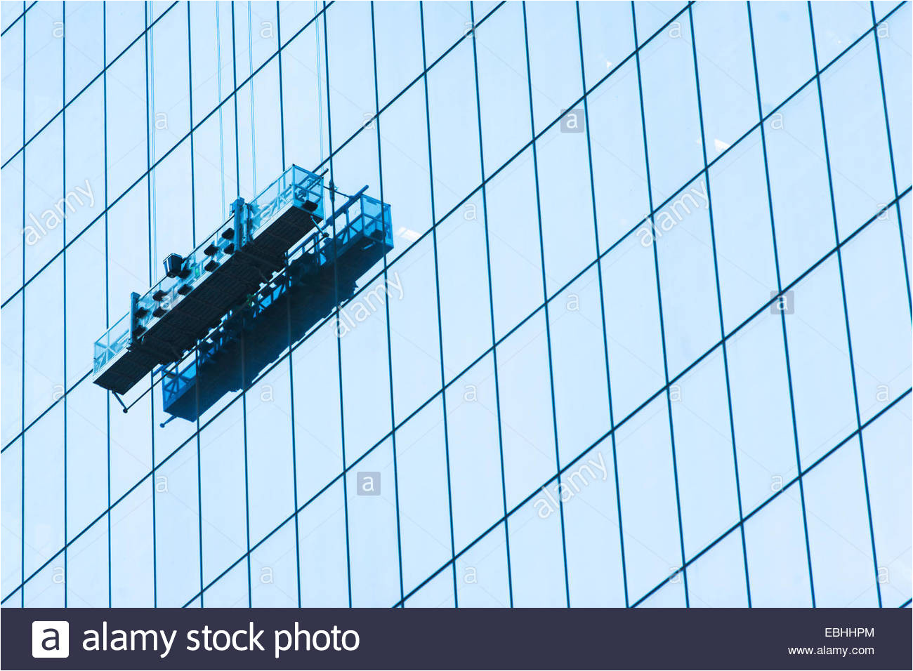 suspended window cleaning platform on glass building stock image