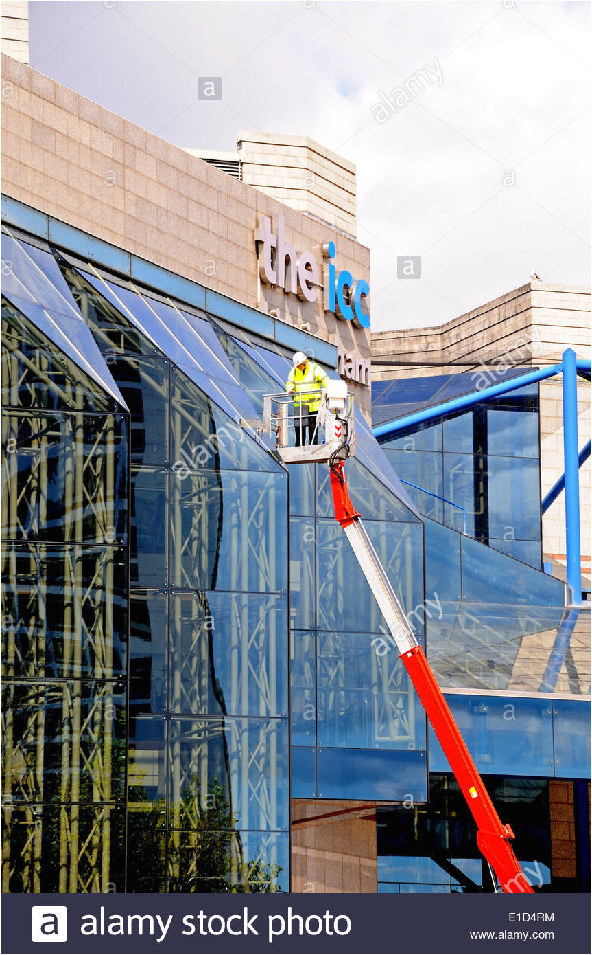 window cleaner cleaning the windows of the international convention centre and symphony hall birmingham