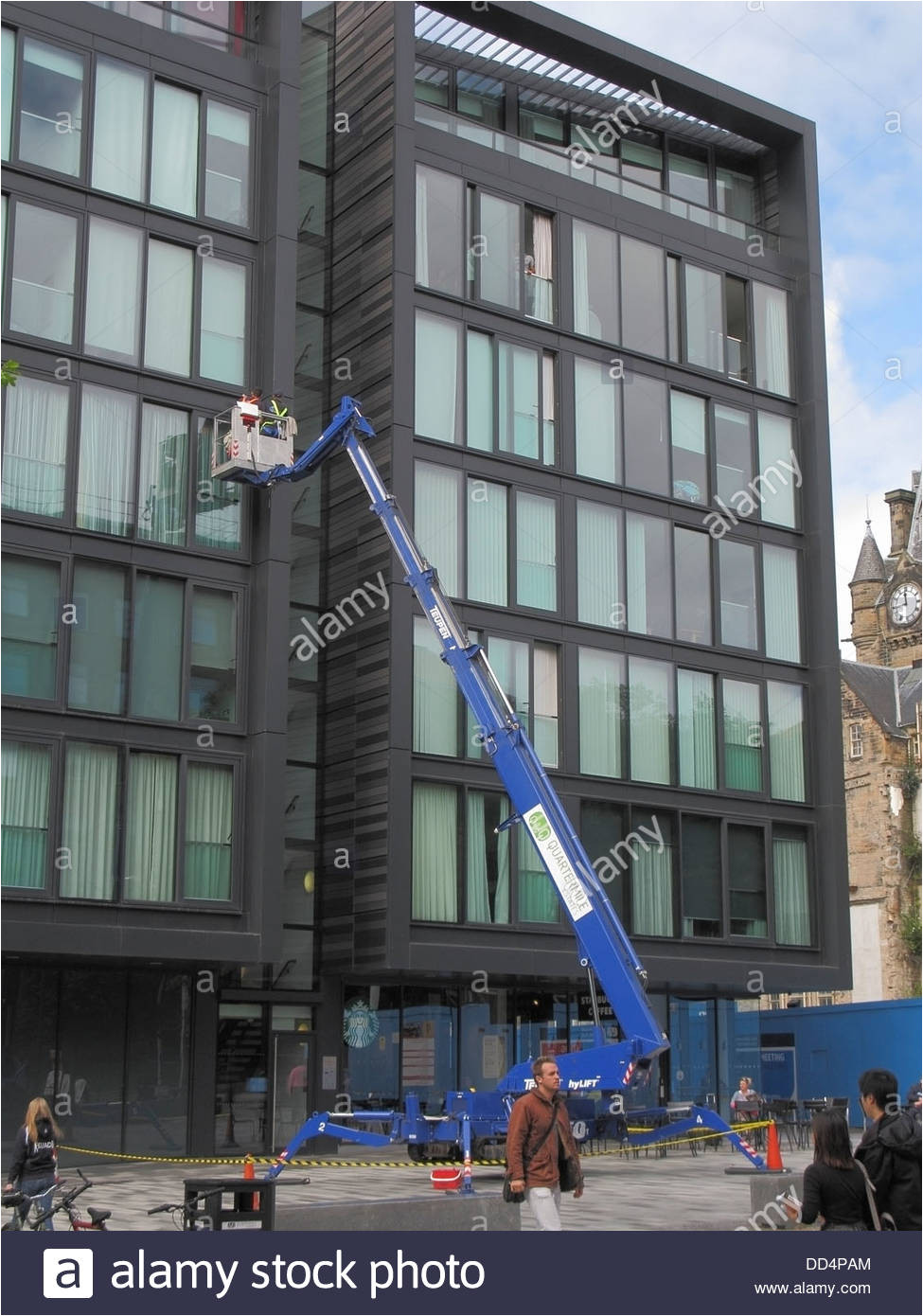 window cleaners using a hydraulic lift or cherry picker on the quartermile development middle meadow