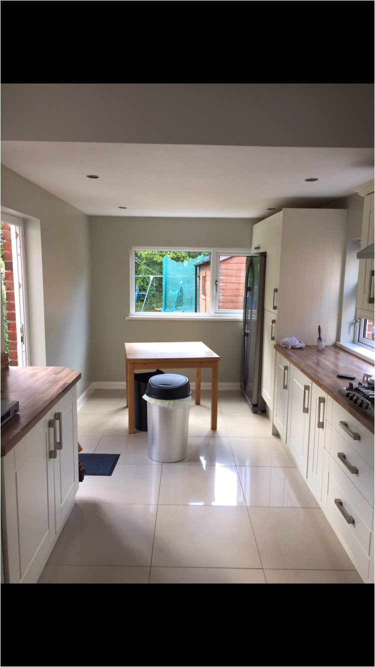 kitchen wall colour in daylight farrow and ball cromarty with cream shaker units and cream high gloss porcelain tiles